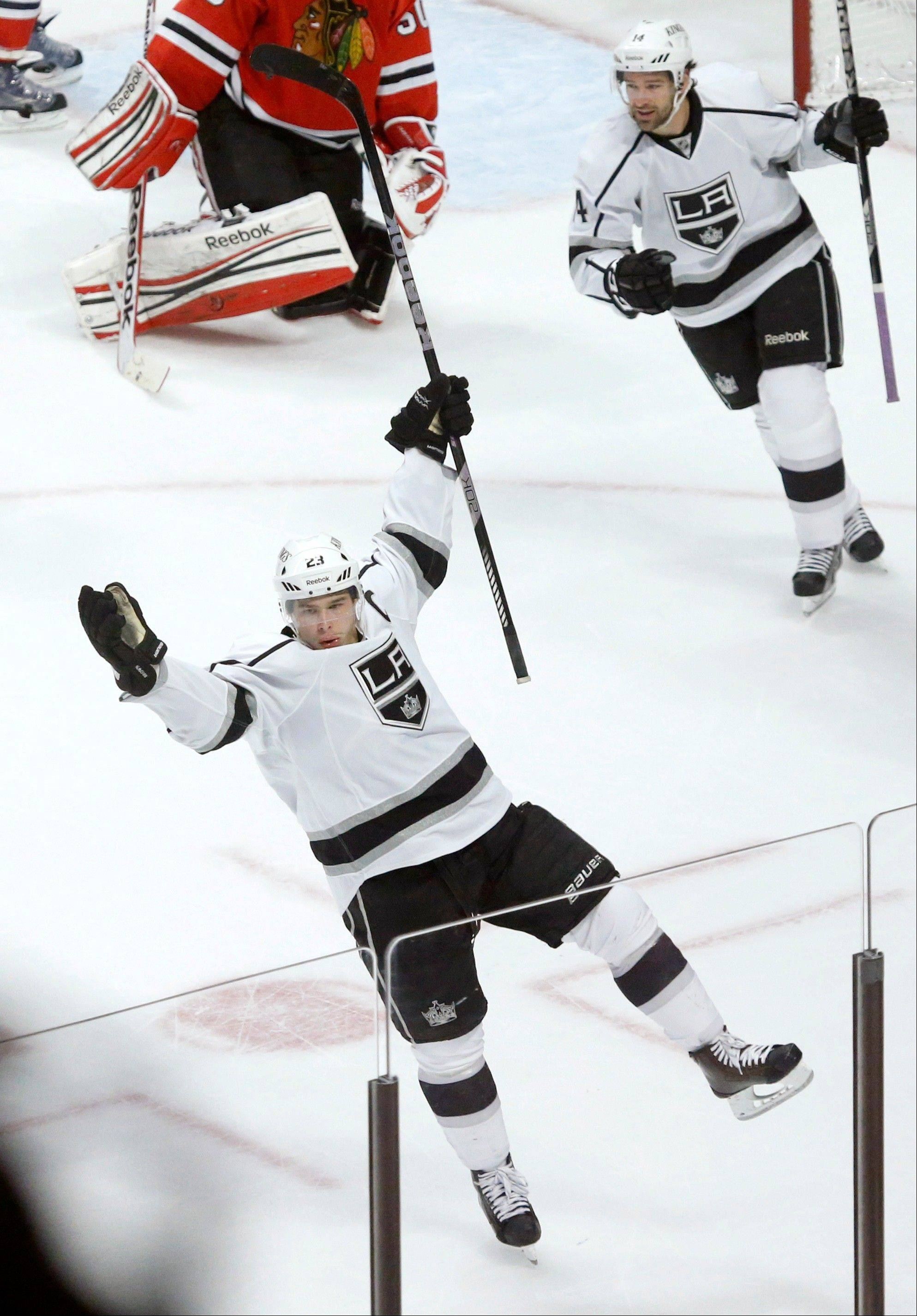 Los Angeles Kings right wing Dustin Brown, bottom, celebrates his winning goal as teammate Justin Williams watches during the third period of an NHL hockey game against the Blackhawks, Monday, March 25, 2013, in Chicago. The Kings won 5-4.