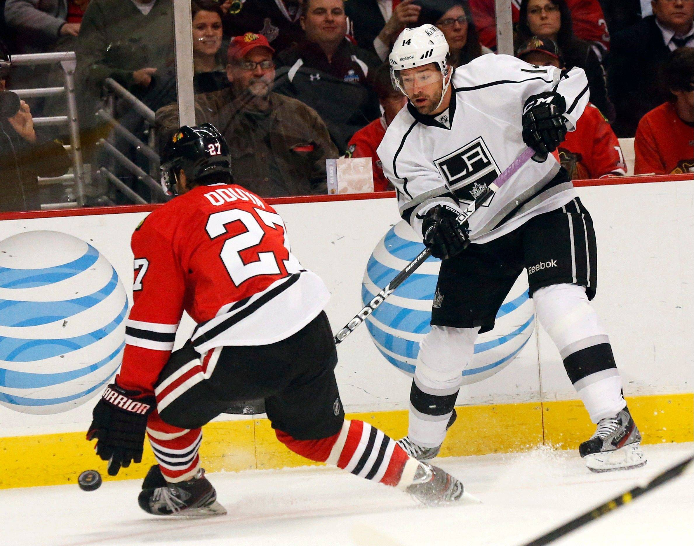 Chicago Blackhawks defenseman Johnny Oduya (27), of Sweden, deflects Los Angeles Kings right wing Justin Williams' shot on goal during the first period.