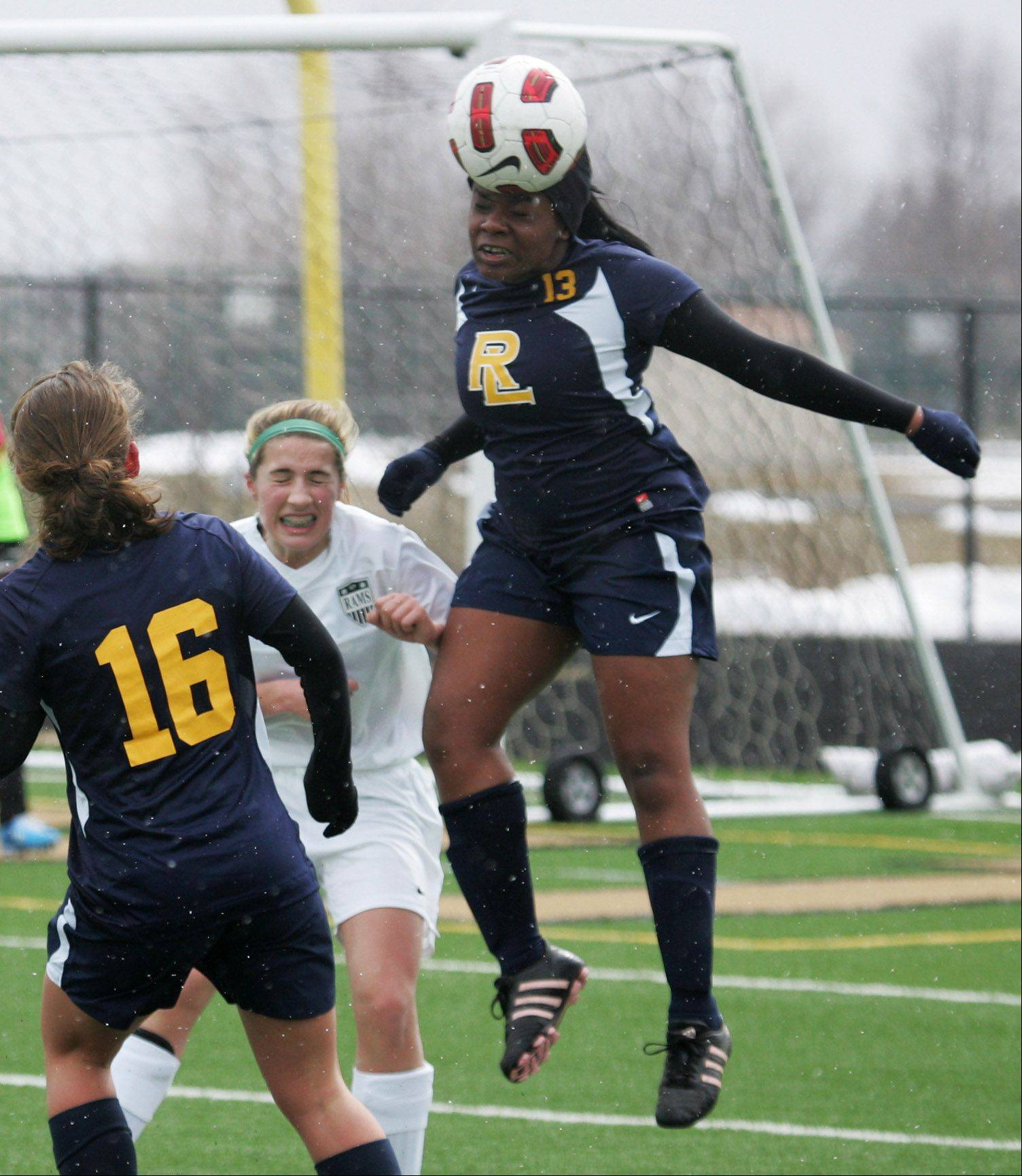 Round Lake defender Naomi Kalume goes up to head the ball in the first half during Monday against Grayslake Central at Grayslake North.