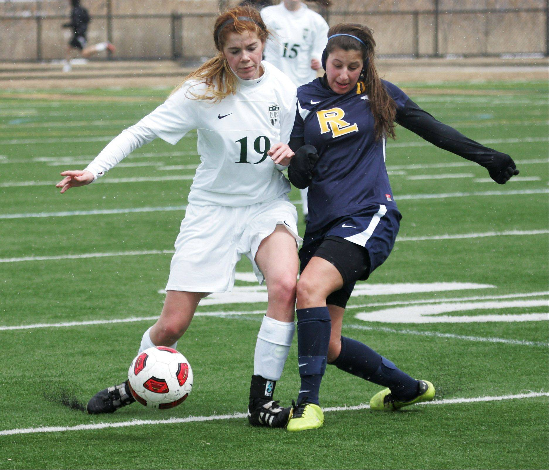 Grayslake Central defender Lauren Spalding battles Round Lake forward Morgin Evins for the ball Monday at Grayslake North.