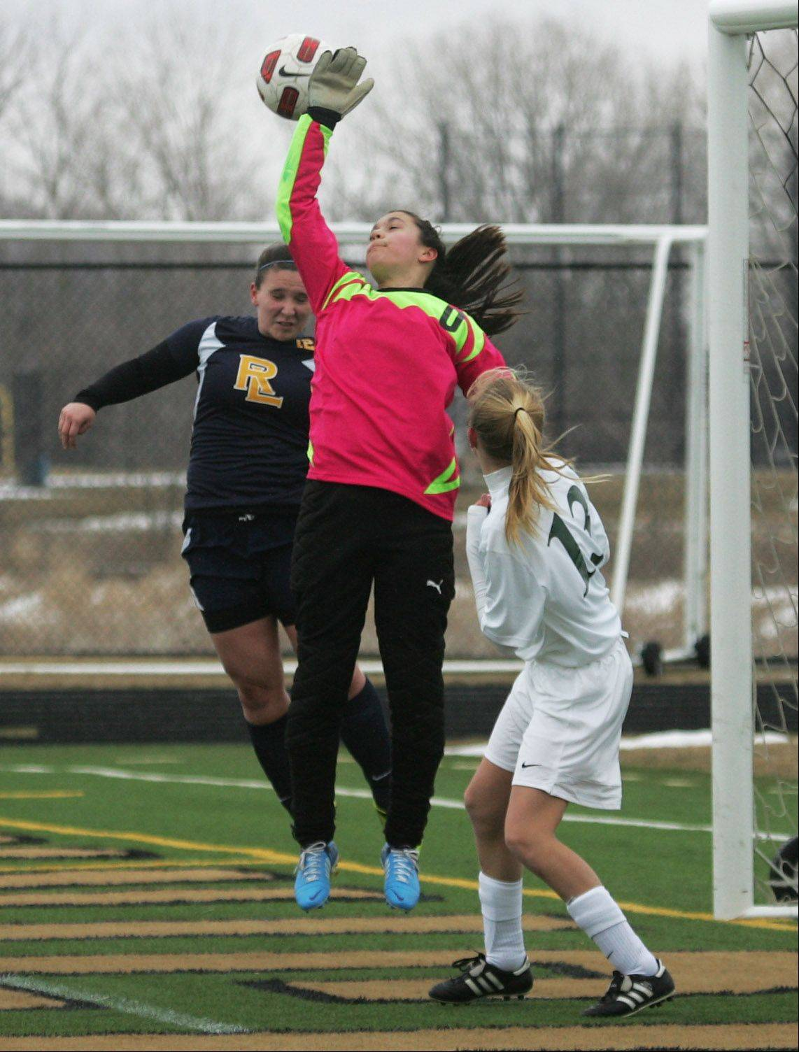 Round Lake goalkeeper Jordan Devera knocks the ball away on a corner kick in the first half against Grayslake Central on Monday at Grayslake North.