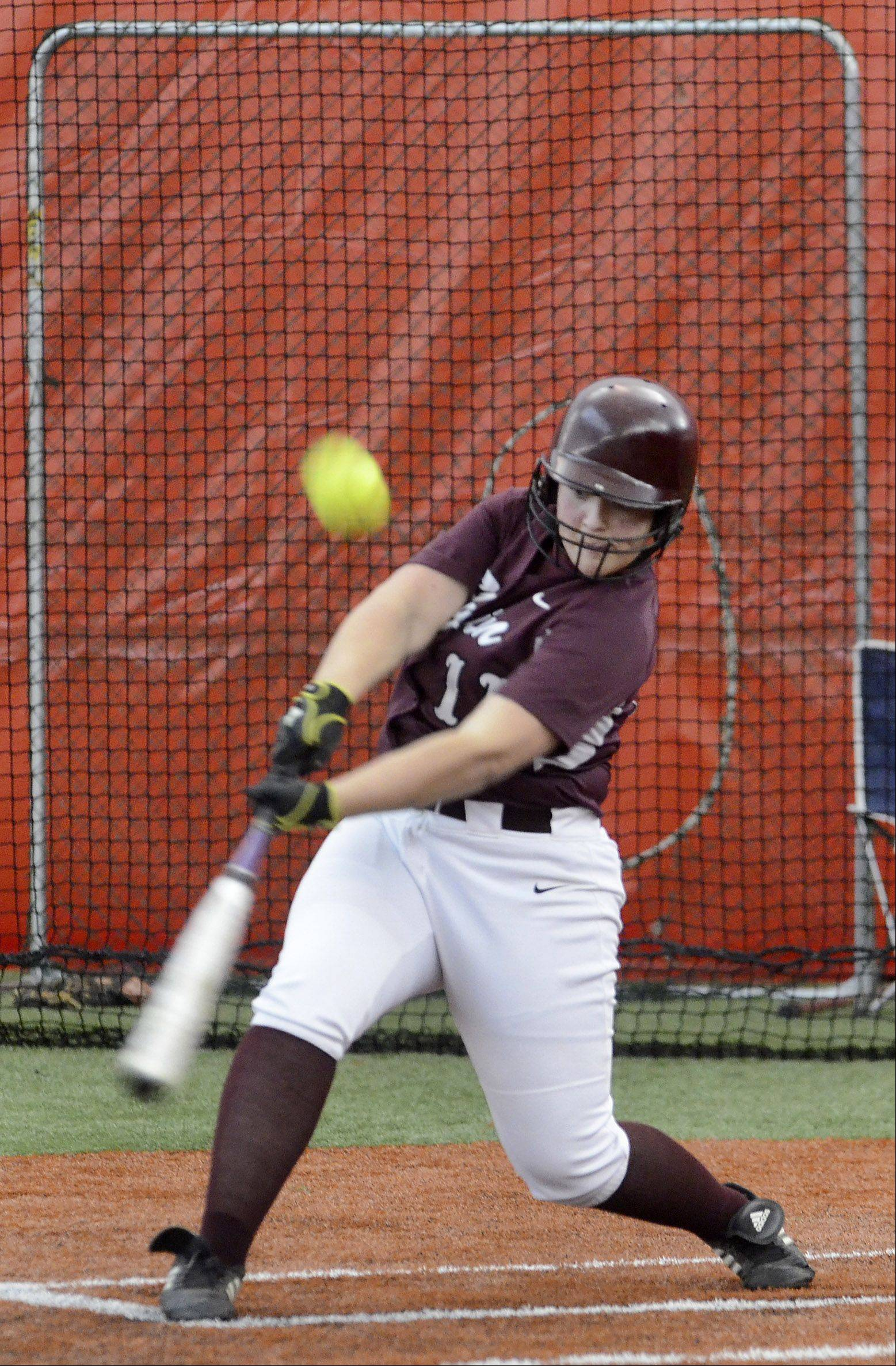 Elgin's Caroline Sobeski pops one up Monday during the Maroons' 3-2 win in eight innings at The Dome at The Ballpark in Rosemont.