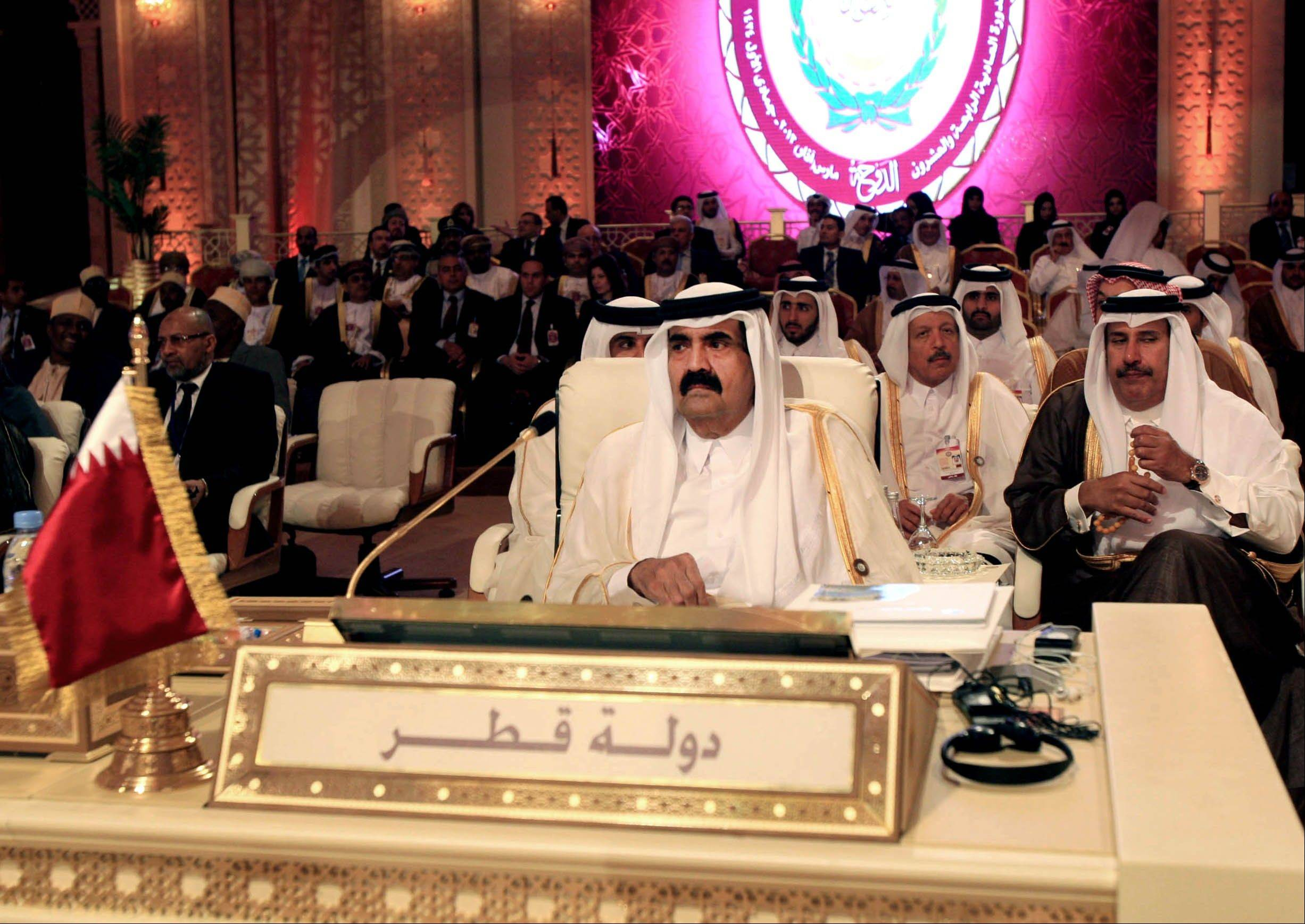 Emir of Qatar Sheik Hamad Bin Khalifa Al Thani, center, attends the opening session of the Arab League Summit in Doha, Qatar, Tuesday.