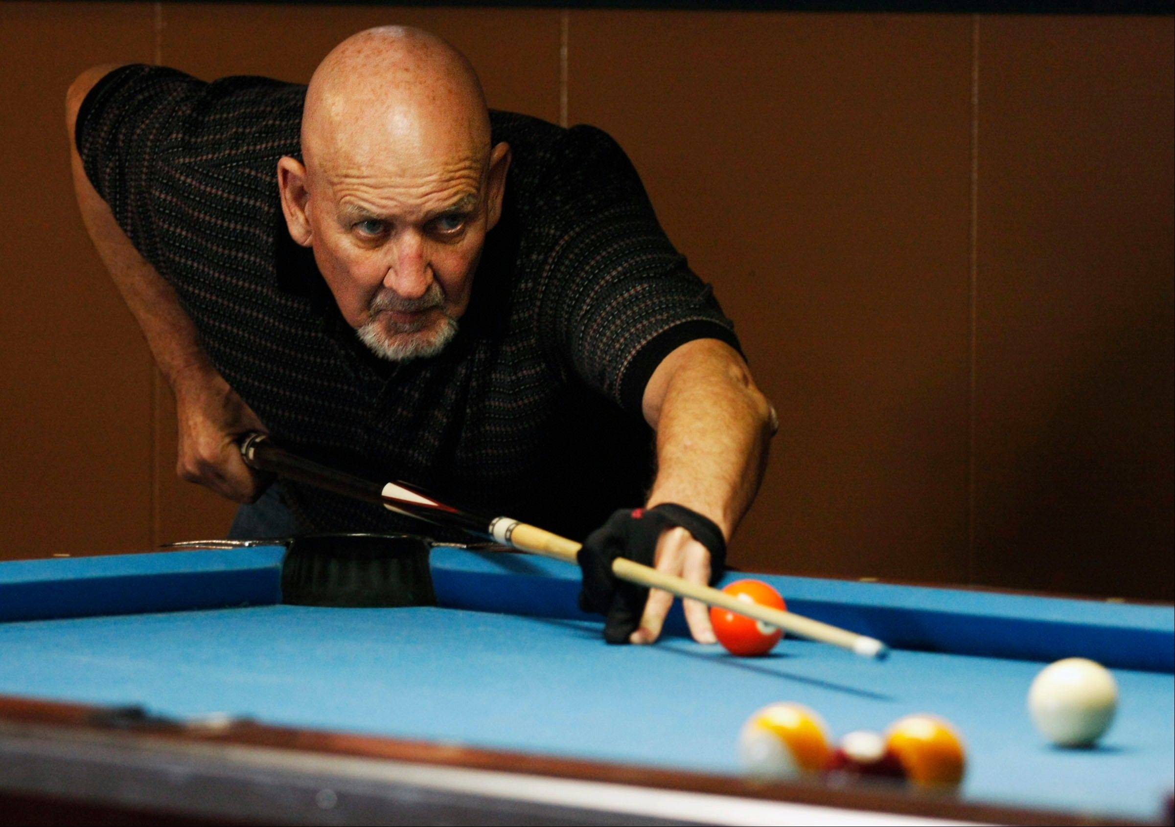 Garry Mitchell, of Findlay, competes in an American Poolplayers Association senior league game at Biggens Bar & Billiards in Decatur.