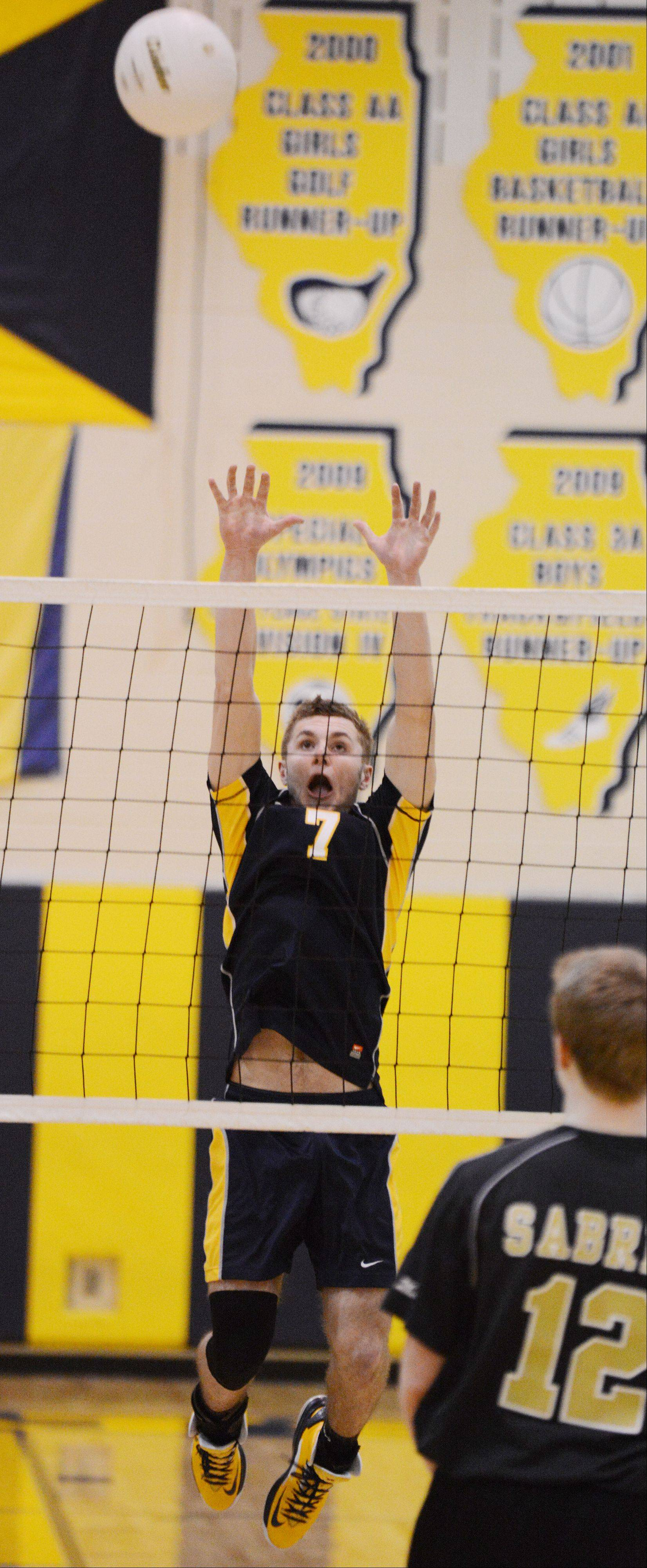 Callahan Rafferty of Neuqua Valley High School goes up for a block during the Streamwood at Neuqua Valley boys volleyball game Tuesday.