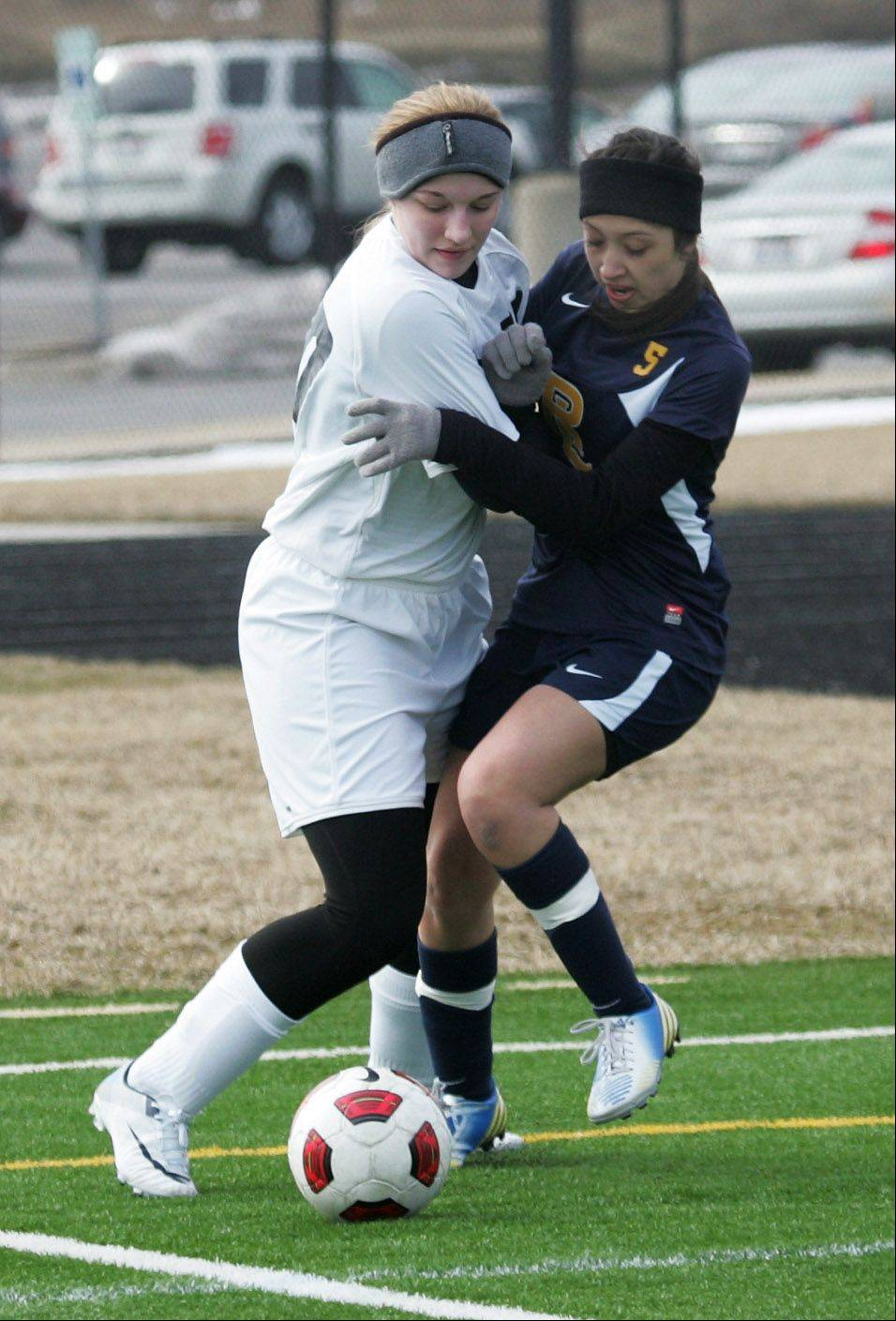Grant forward Marissa Allen, left, battles Round Lake defender Erika Quevedo on Tuesday at Grayslake North.