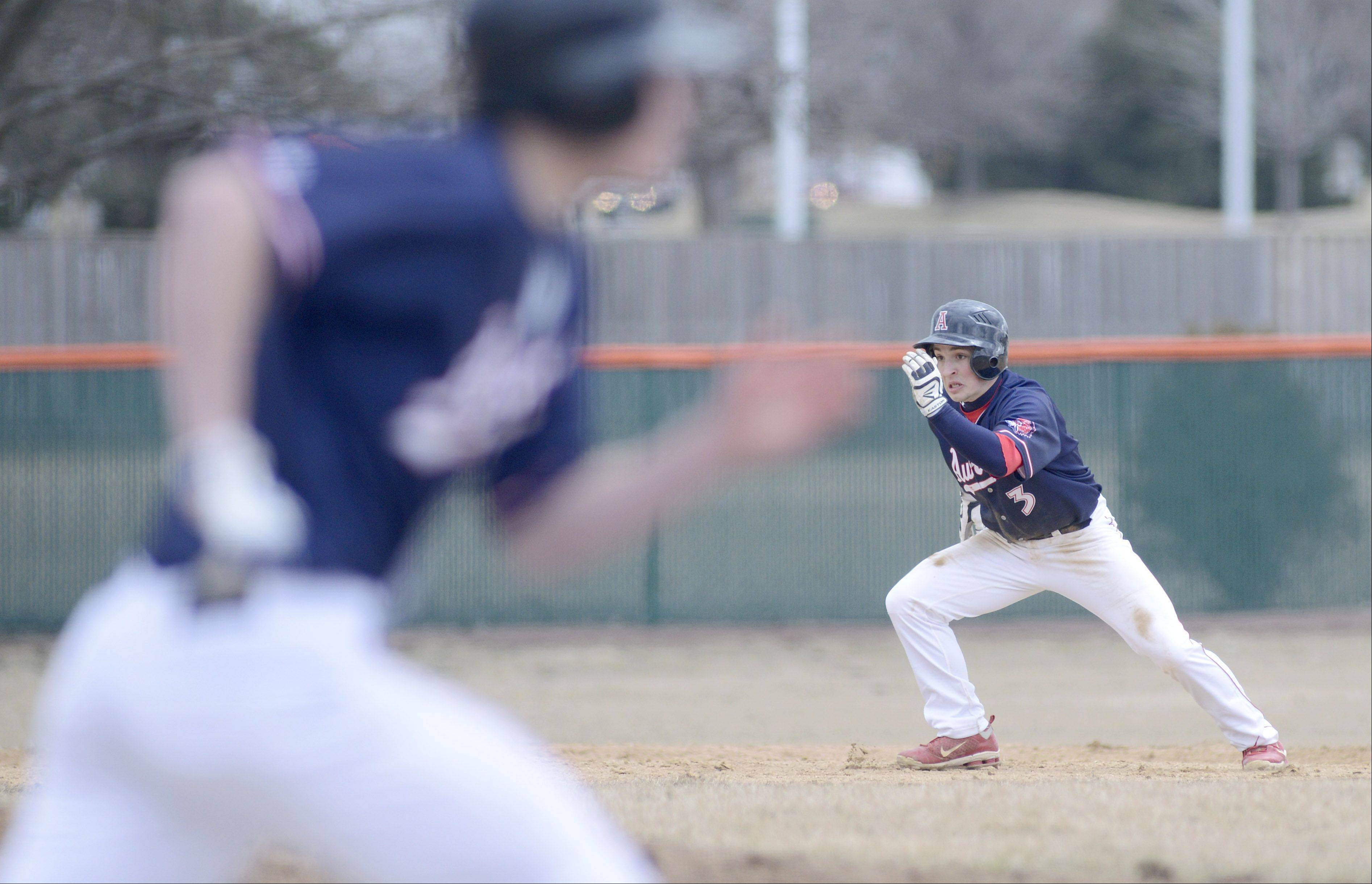 West Aurora�s Adam Lipscomb races for third base in the third inning vs. St. Charles East on Tuesday, March 26.