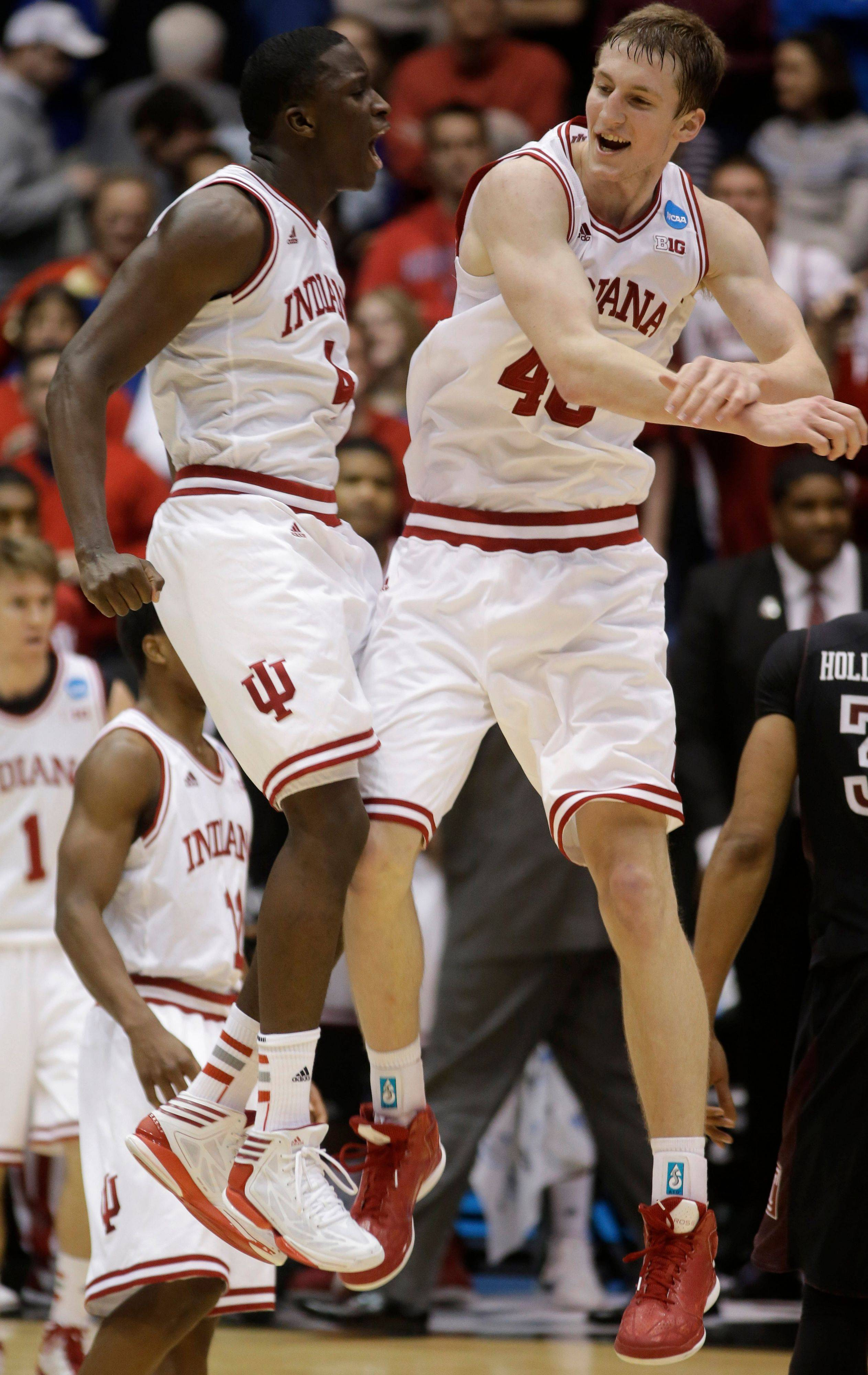 Indiana's Victor Oladipo, left, and Cody Zeller celebrate after they became one of four Big Ten teams in the Sweet Sixteen.