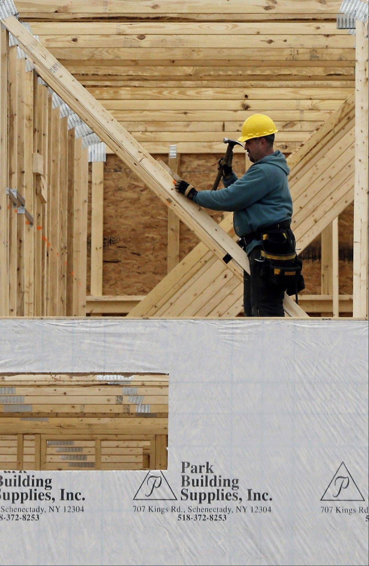 A new townhouse is under construction at the Crossings adult community in Colonie, N.Y. Sales of new homes fell in February after climbing to the highest level in more than four years in January.
