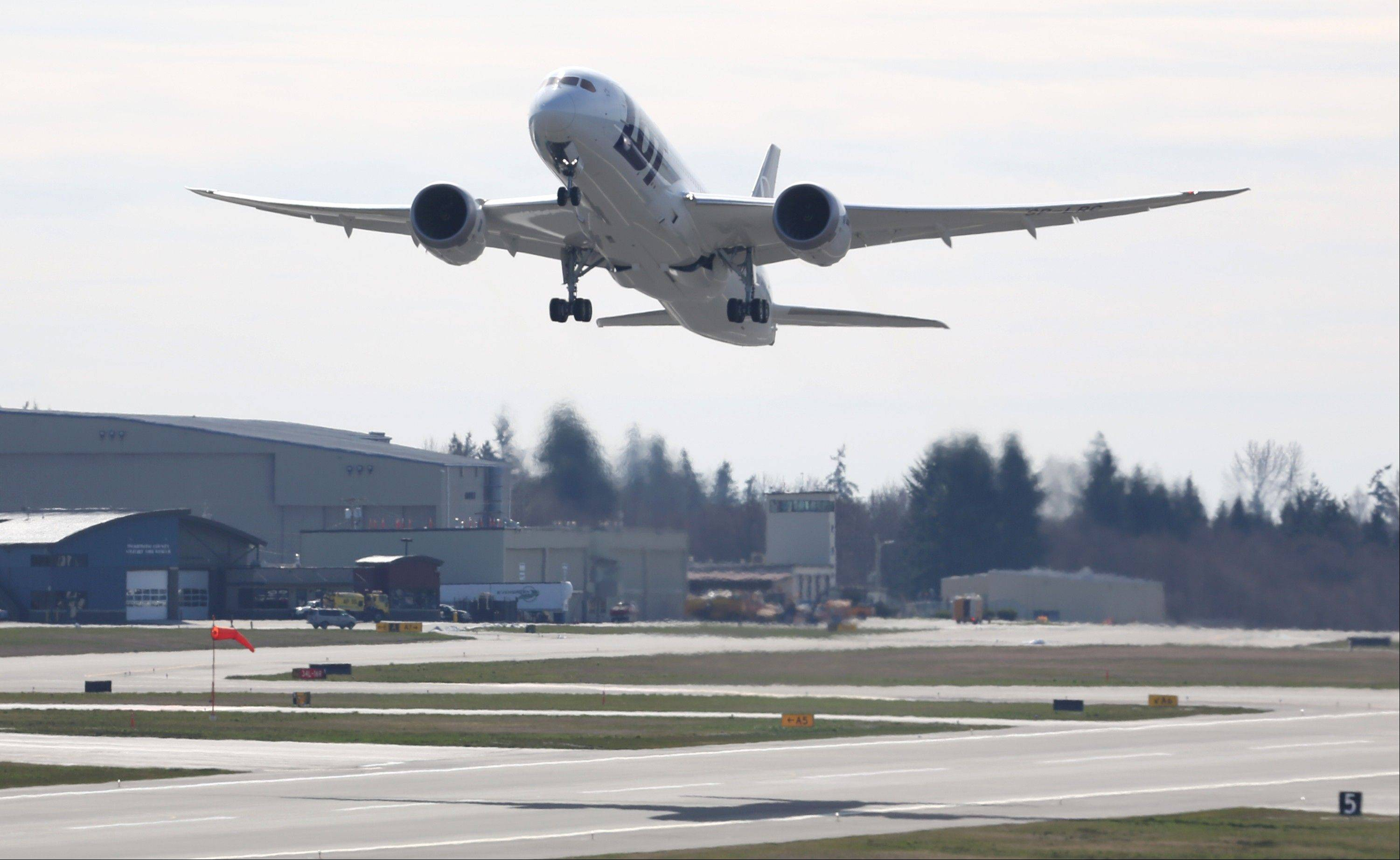 A Boeing 787 lifts off on Monday, at Paine Field in Everett, Washington. This was the first test flight of a 787 since the fleet was grounded because the danger of a fire with the lithium-Ion battery in the plane.