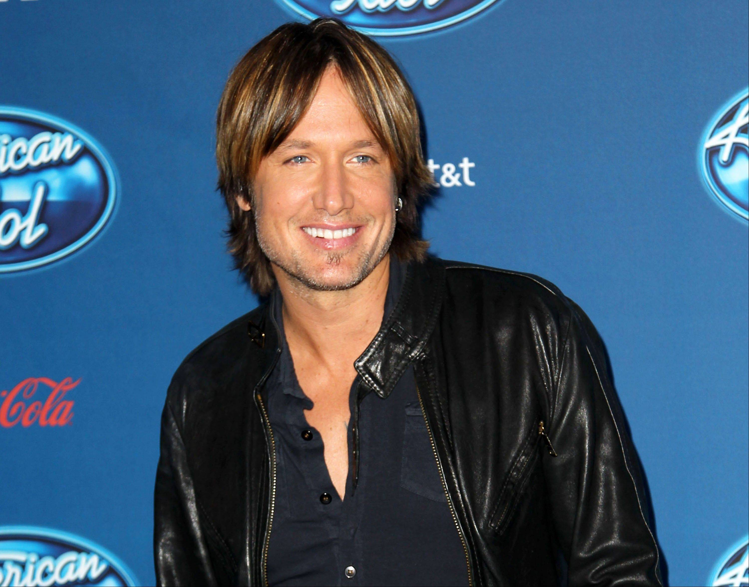 "Keith Urban is a busy man as a judge on ""American Idol"" in addition to planning a summer tour and working on a new album among other things."