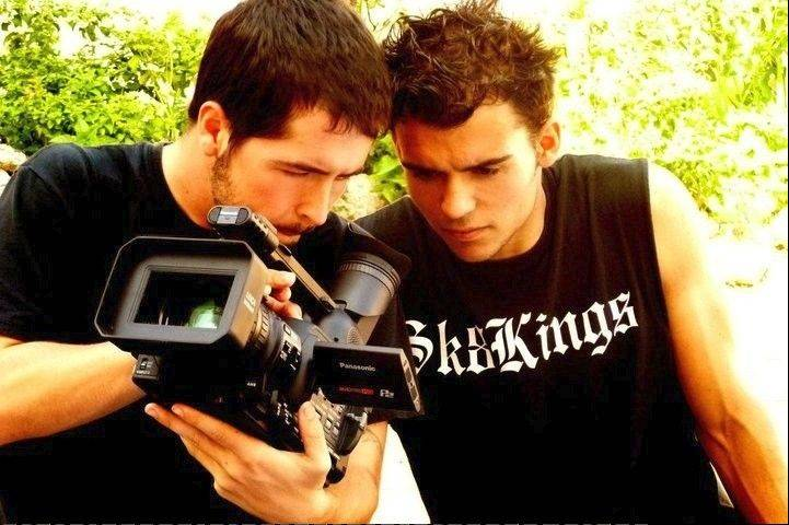 Filmmaker Brett Novak of Lombard, left, shows some of the footage to Kilian Martin, the international skateboarding pro featured in his films.