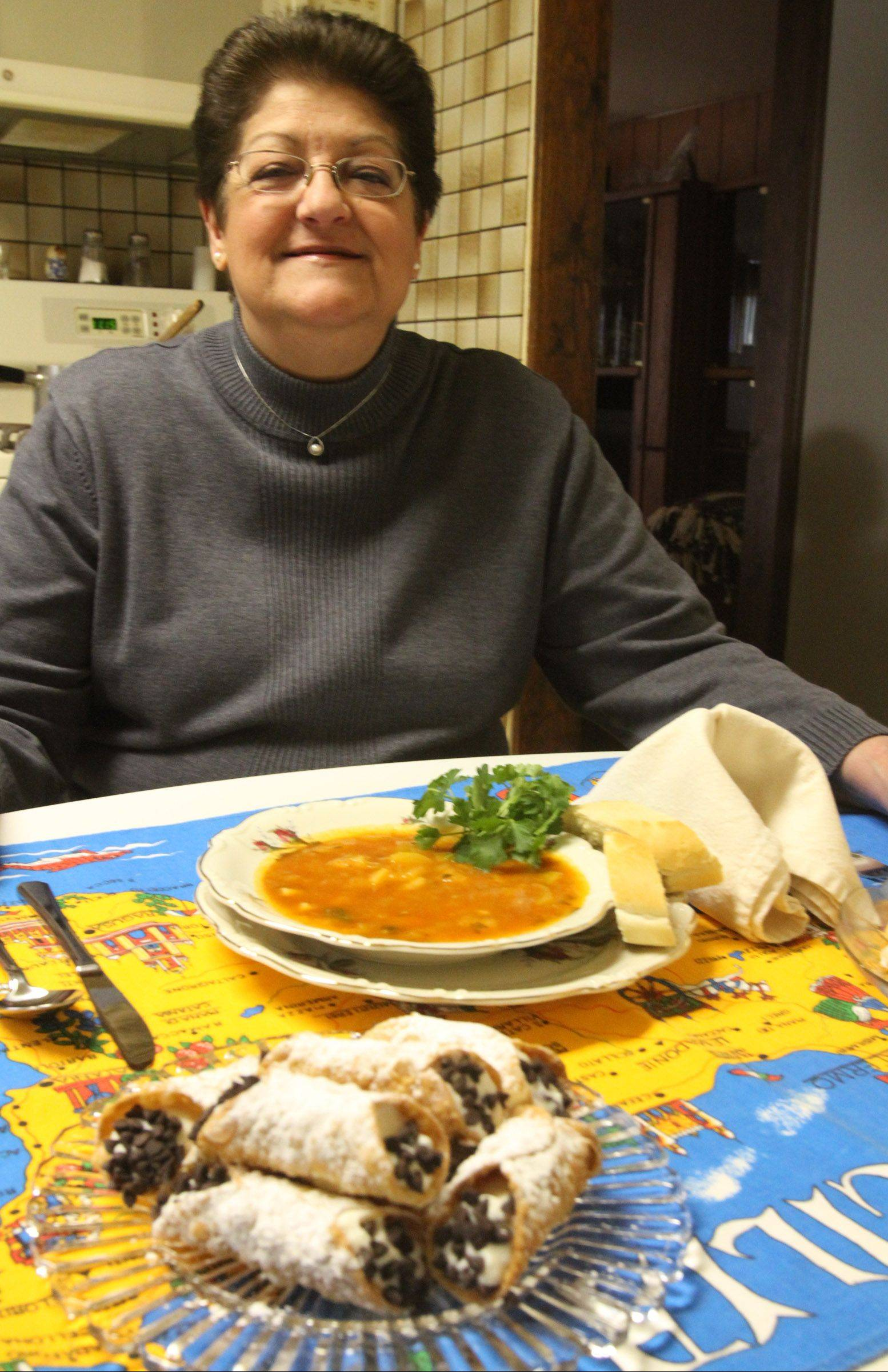 Angie Gergen makes Italian favorites zucchini soup, Italian cookies and canolli in her Hoffman Estates kitchen.
