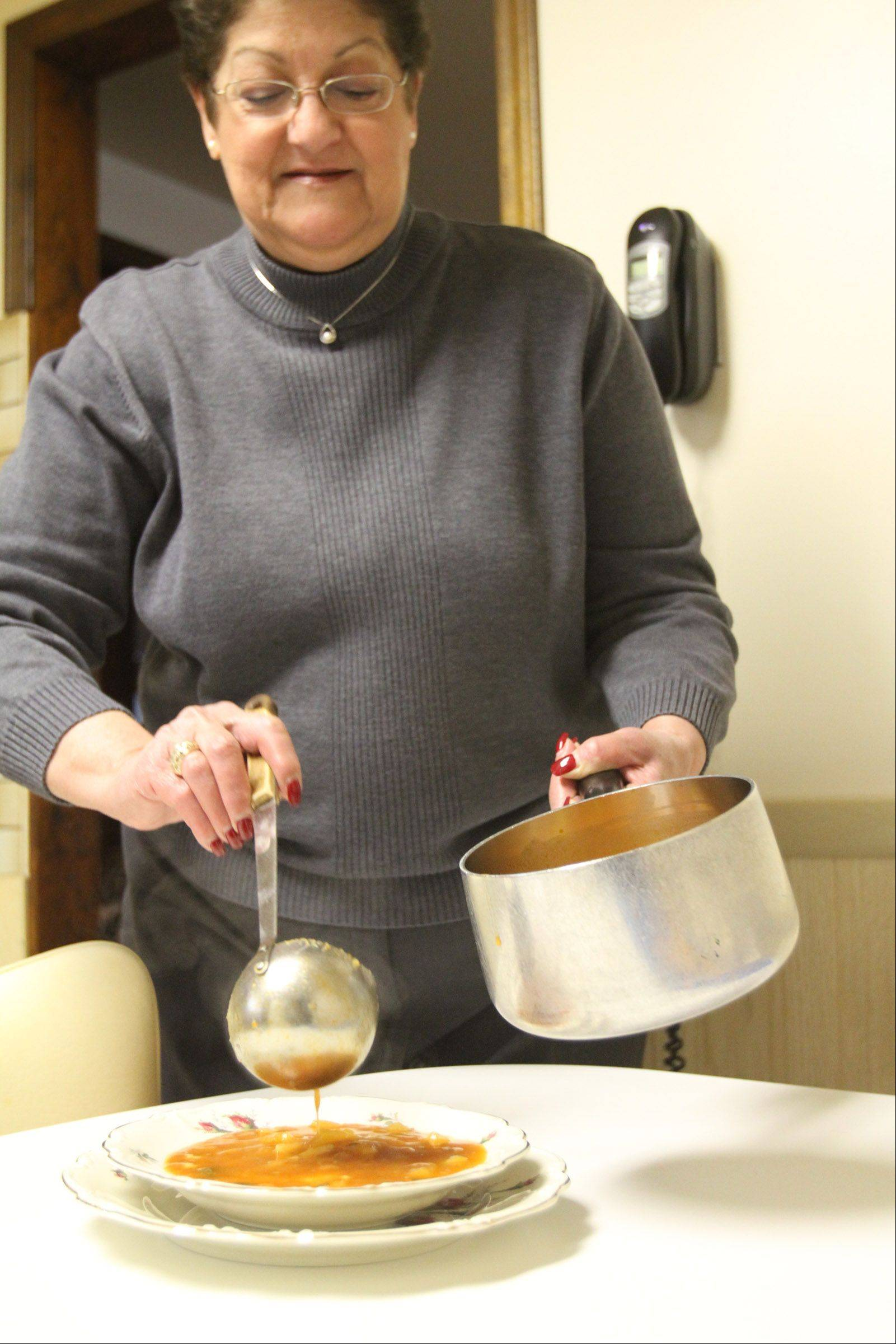 Angie Gergen makes zucchini soup in her kitchen in Hoffman Estates.