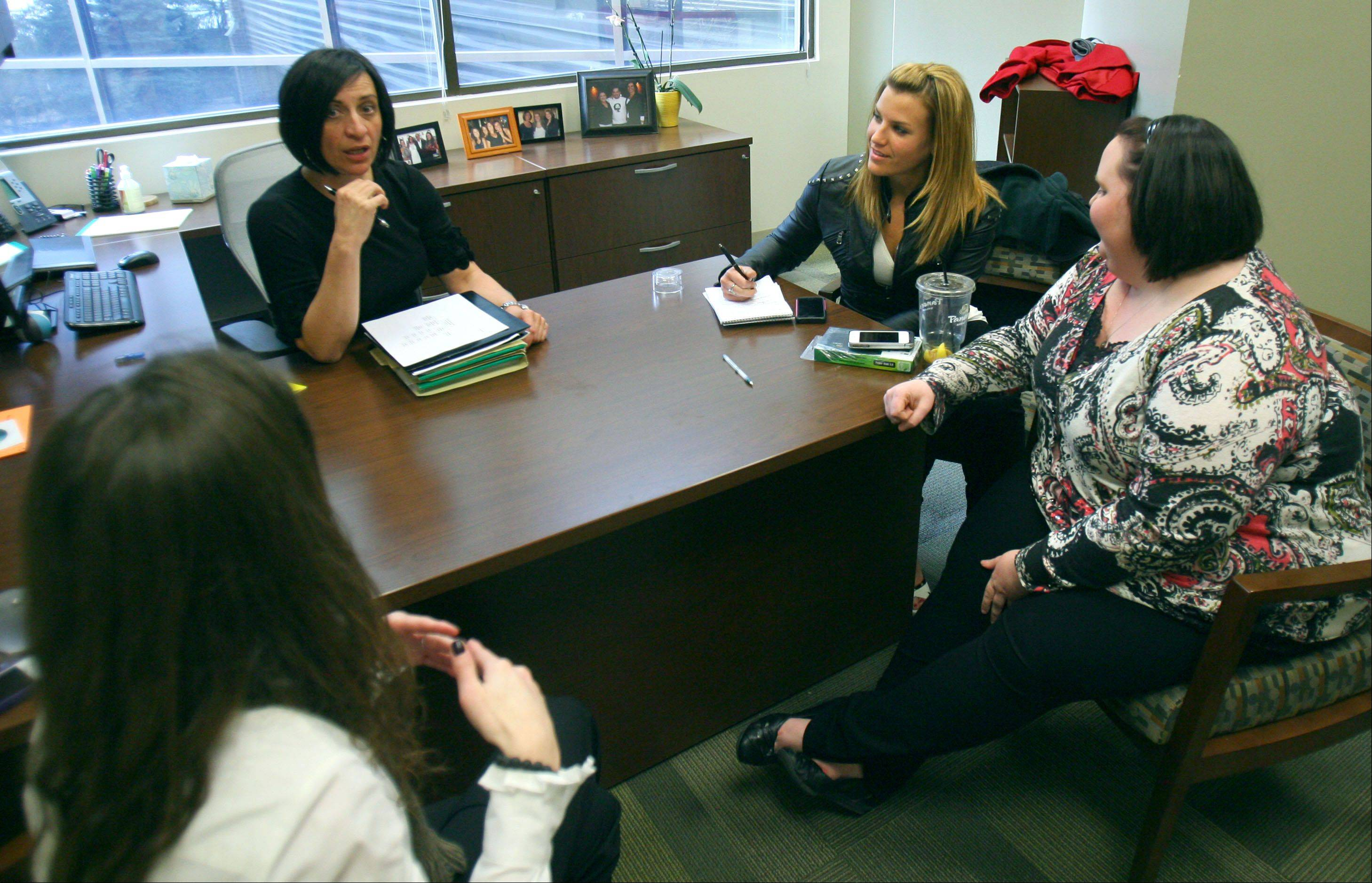 "Clockwise from left: Lindsey Penfold, Zrinka Allen, Danni Allen and Molly Beckman participate in a meeting at Camping World in Lincolnshire. Allen, a Wheeling resident, won NBC's reality weight loss show ""Biggest Loser"" last week and is back at work."