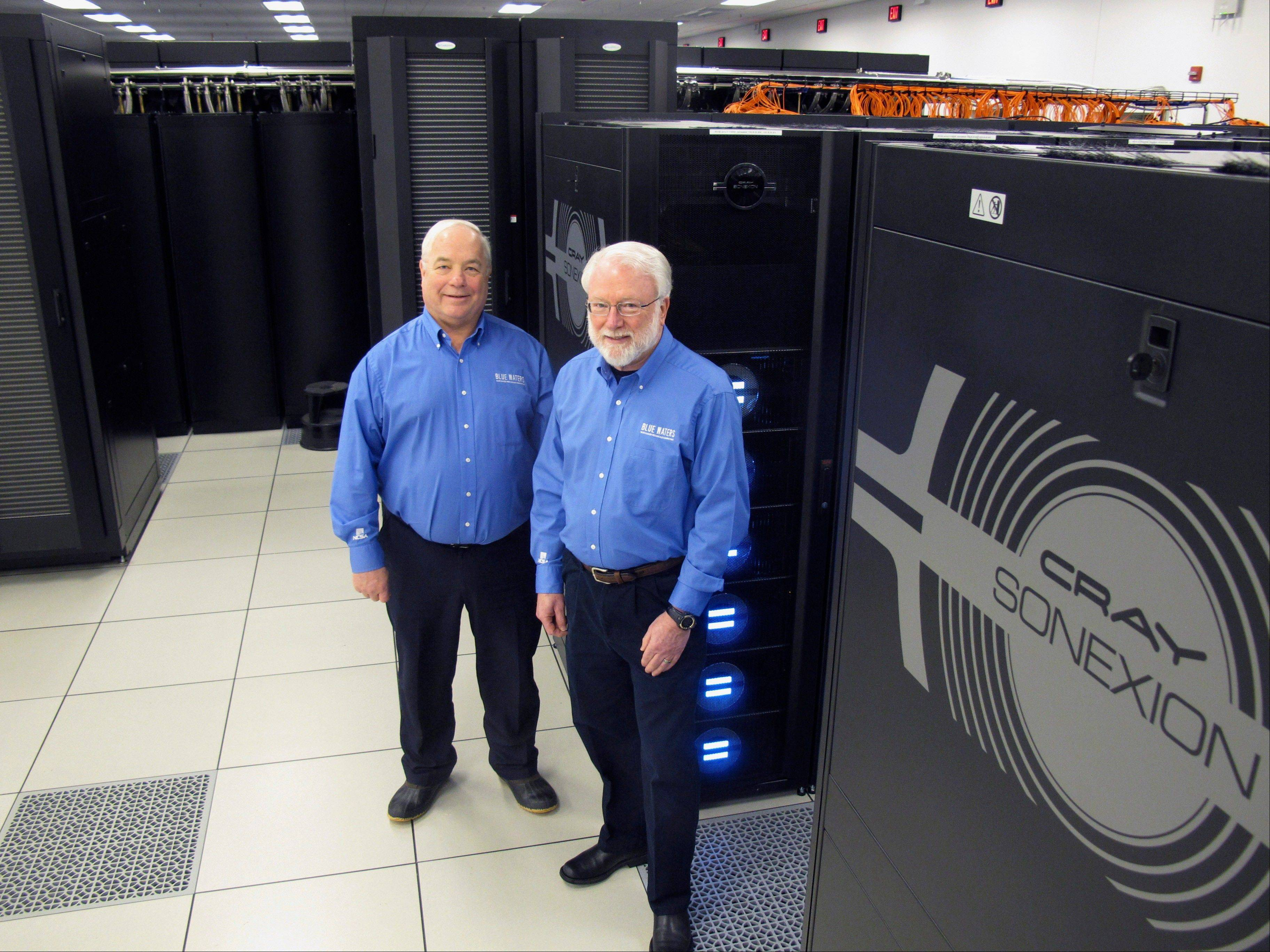 Blue Waters project director Bill Kramer, left, and National Center for Supercomputing Applications Director Thom Dunning pose alongside the storage system for the Blue Waters supercomputer at the University of Illinois in Champaign.