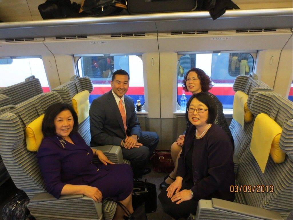 Marion Flaman, top right, on the train to Fukushima with, clockwise, Emily Murase, Hirano Inouye and Kelly Ogilvie.