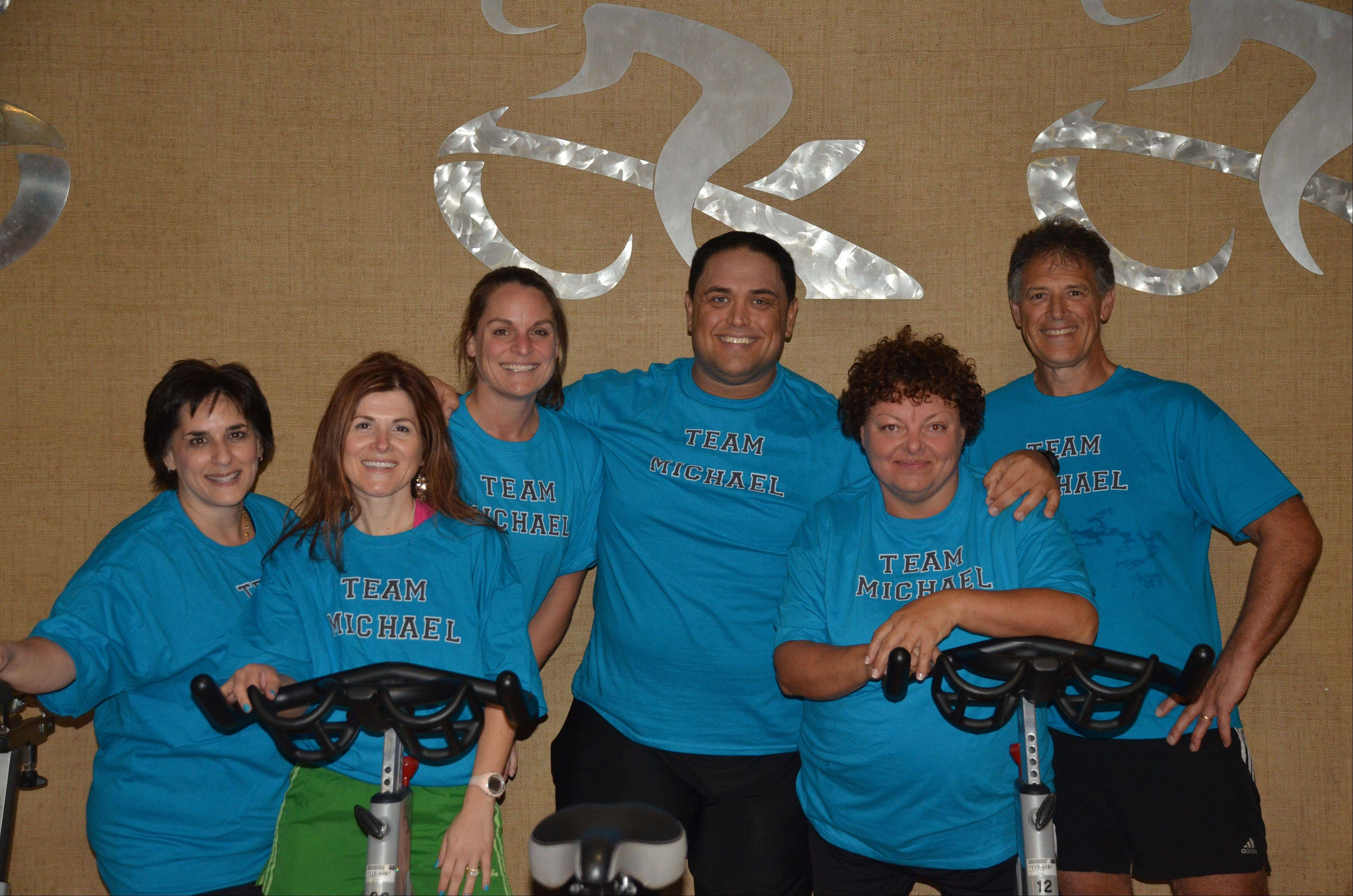 "A spin class that Michael Ventrella, center, leads, surprised him with Team Michael T-shirts. Though he's gained back some of the pounds dropped when he won season nine of ""The Biggest Loser,"" Ventrella remains fit and works as a trainer."