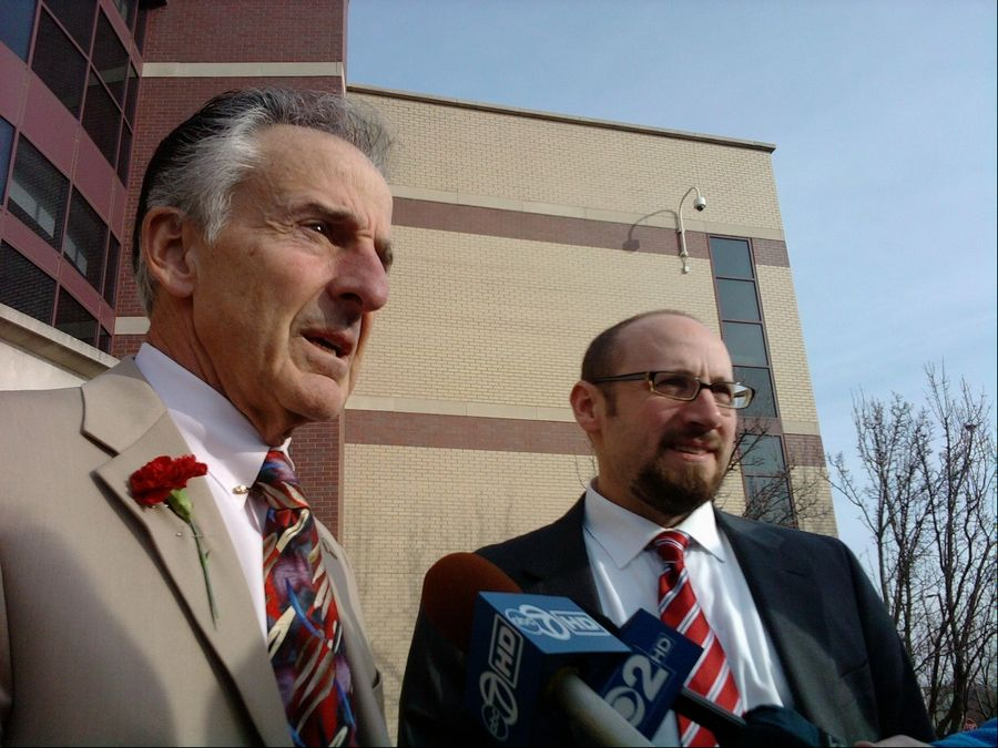 McHenry County State's Attorney Louis Bianchi, left, and Assistant State's Attorney Michael Combs discuss the mistrial in the 2002 murder of Brian Carrick in February 2012.