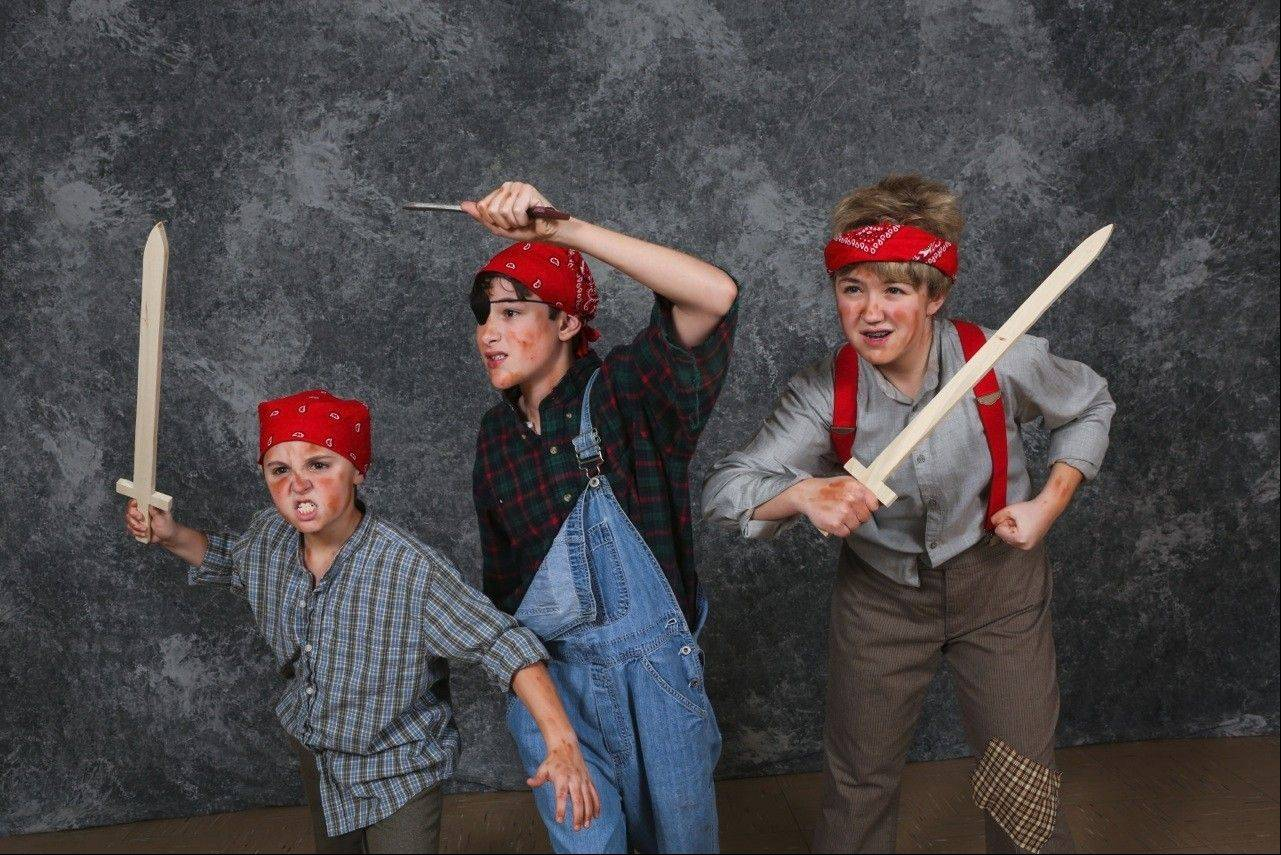 "Cast members of the Kirk Players production of ""Tom Sawyer"" dress as pirates. The play was written by Tim Kelly, based on the work of Mark Twain."
