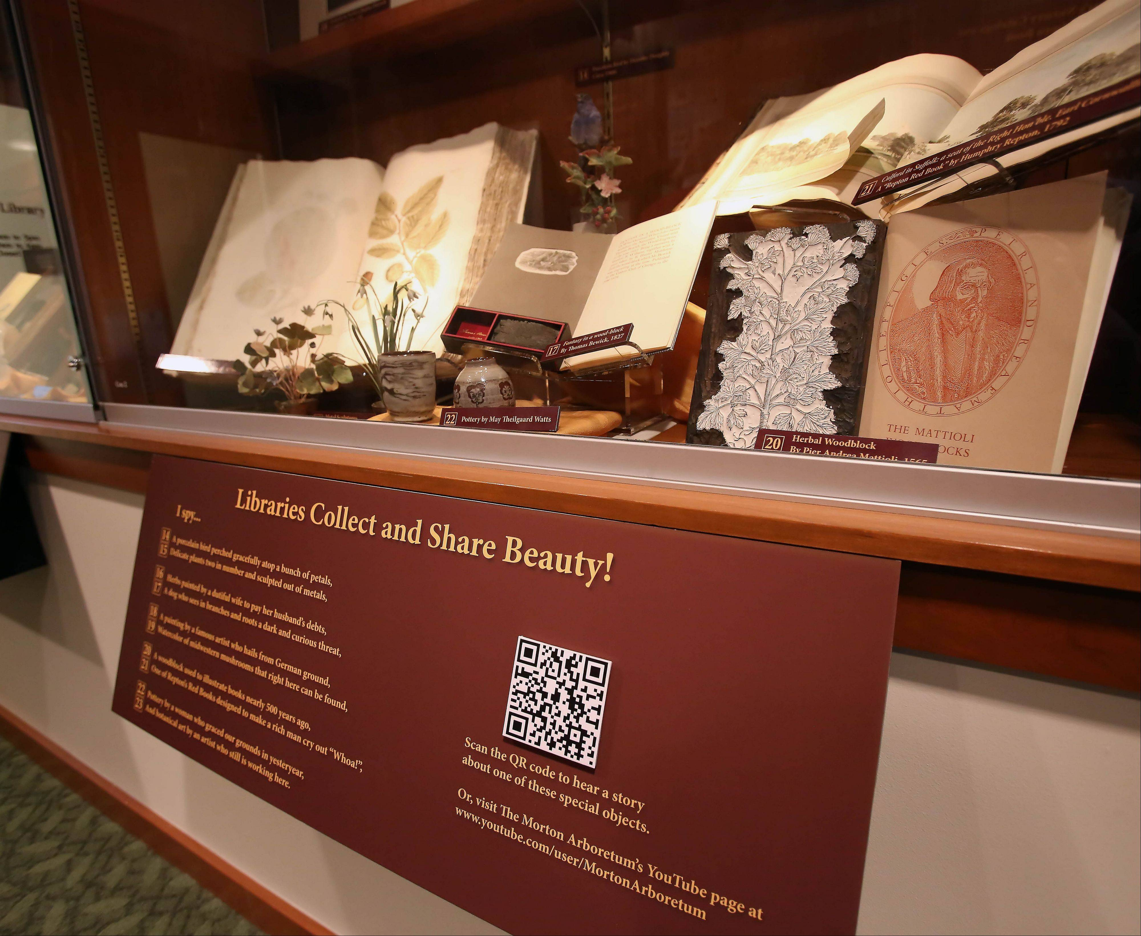 The exhibit includes QR codes that patrons can scan into their smartphones for more information on particular items.