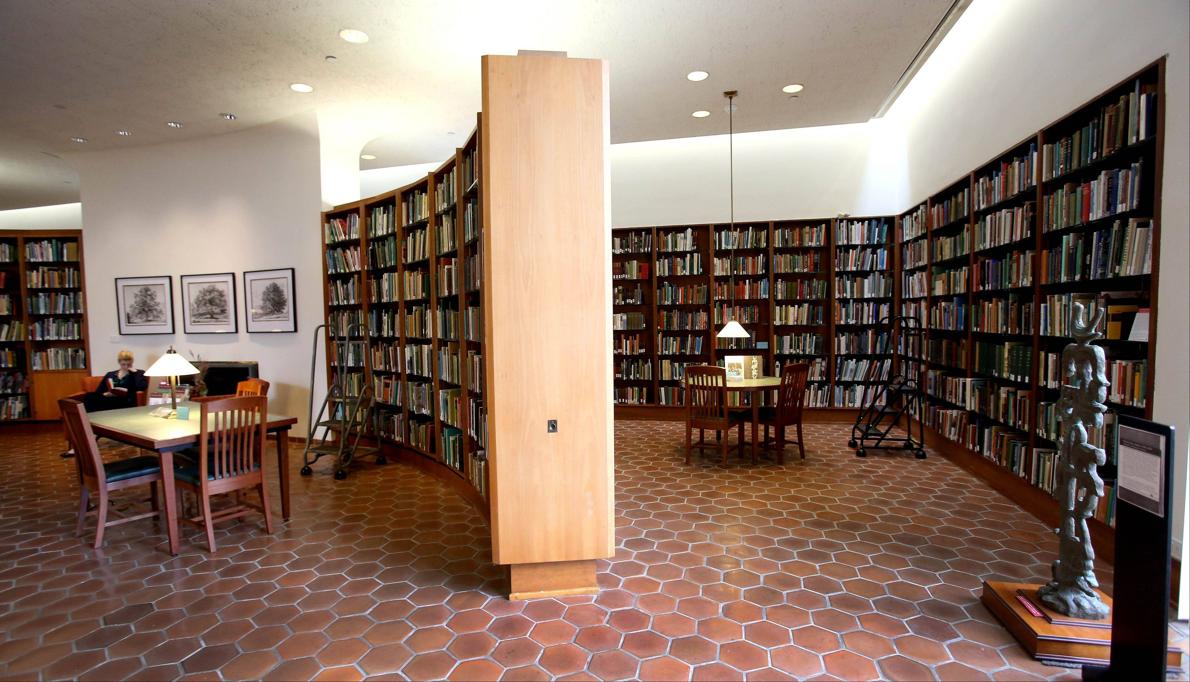 Designed by noted Chicago architect Harry Weese, the Sterling Morton Library located in the Morton Arboretum's administration building includes carved cherry bookcases and, just outside the window, the intimate May T. Watts Reading Garden.