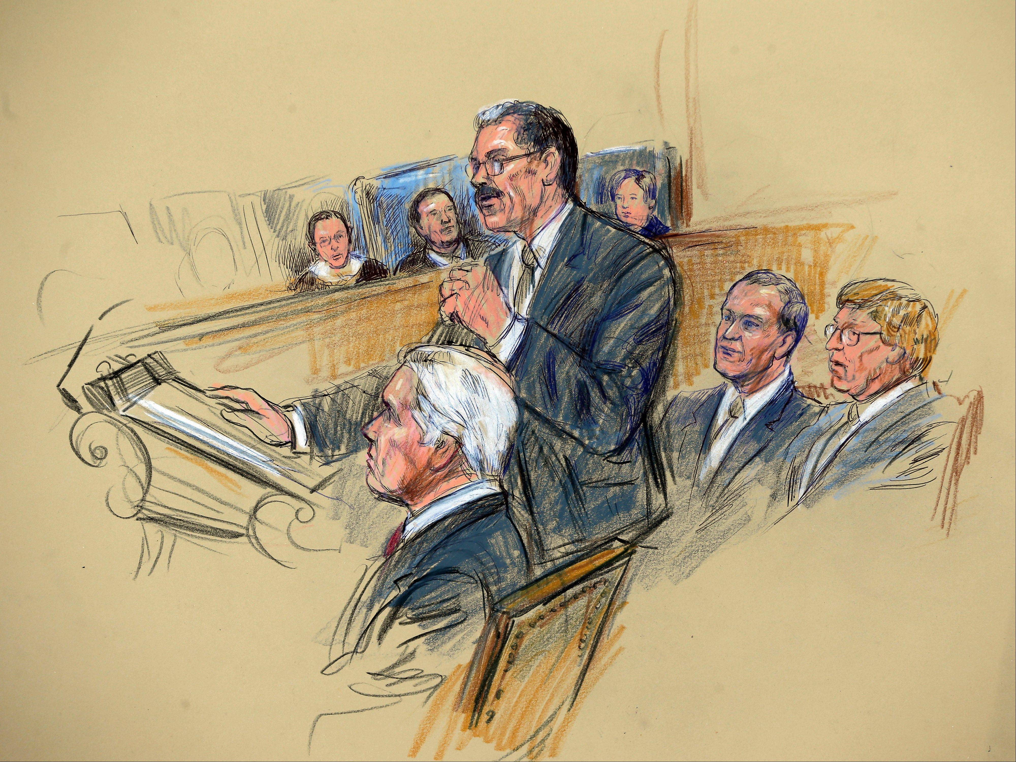 This artist rendering shows Solicitor General Donald B. Verrilli Jr., center, addressing the Supreme Court in Washington, Tuesday.