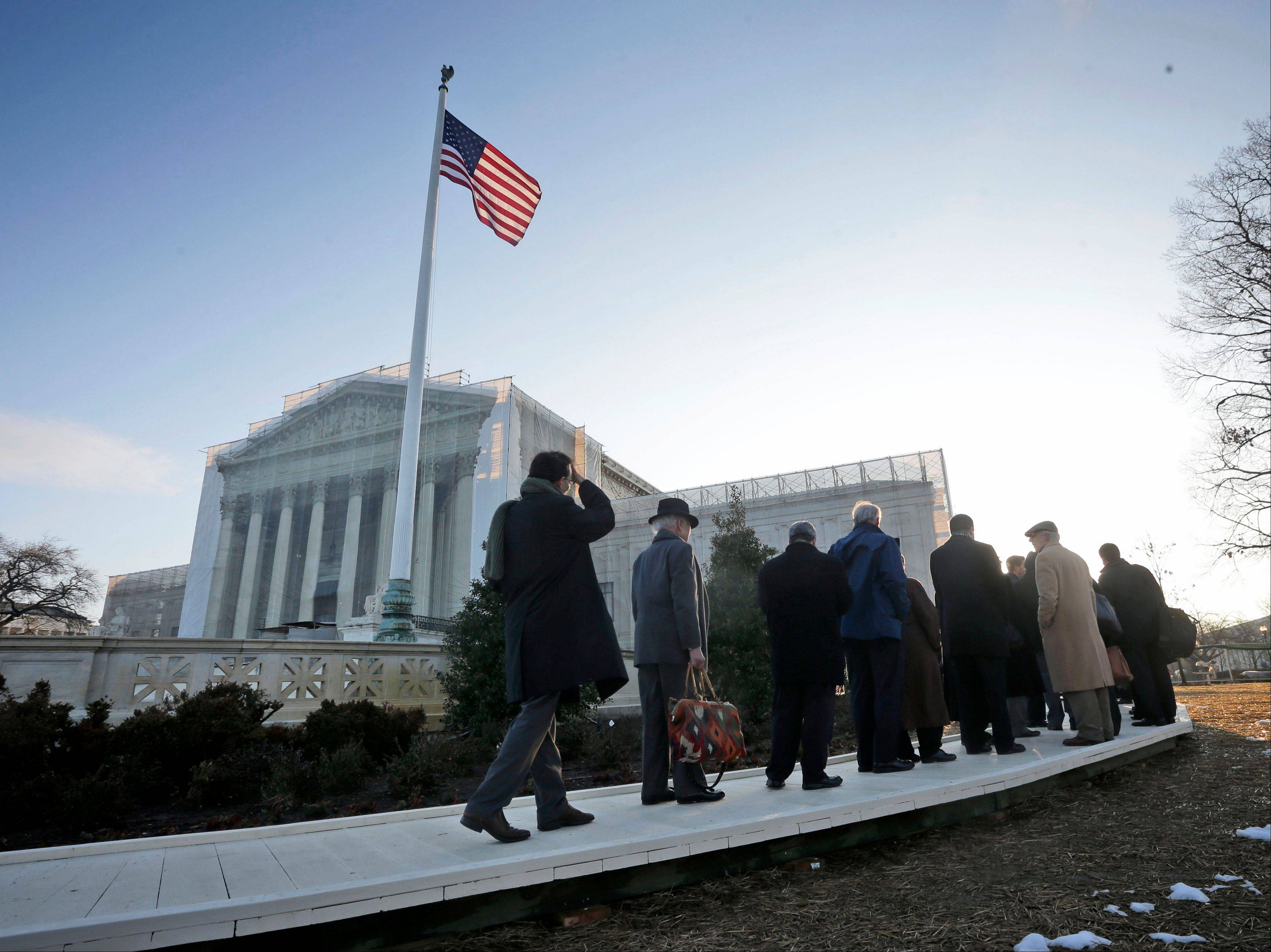 People make their way inside into the Supreme Court Today in Washington for the court's hearing on Californiaís voter approved ban on same-sex marriage, Proposition 8.