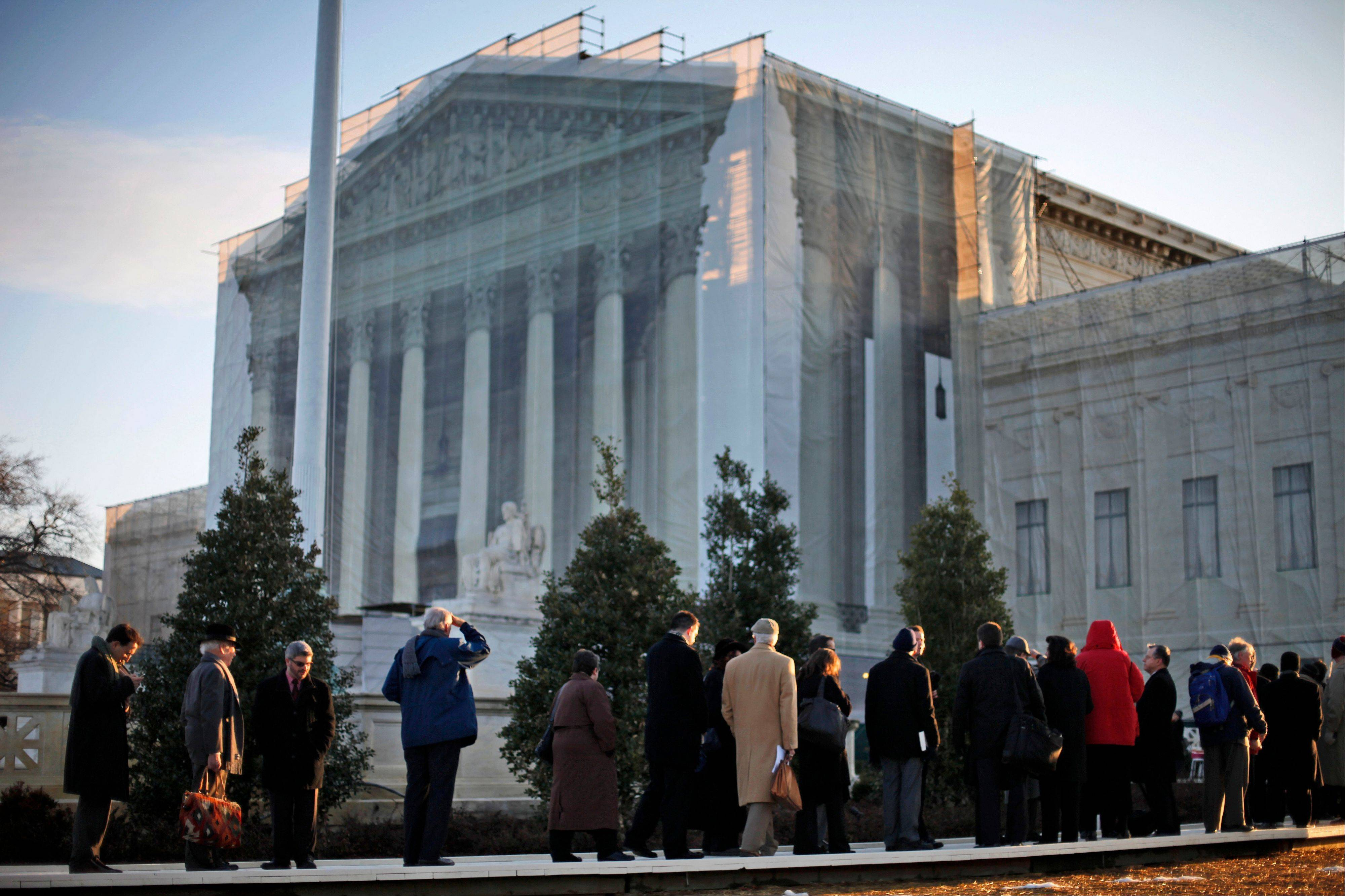 People line up for entrance into the Supreme Court in Washington, Tuesday.