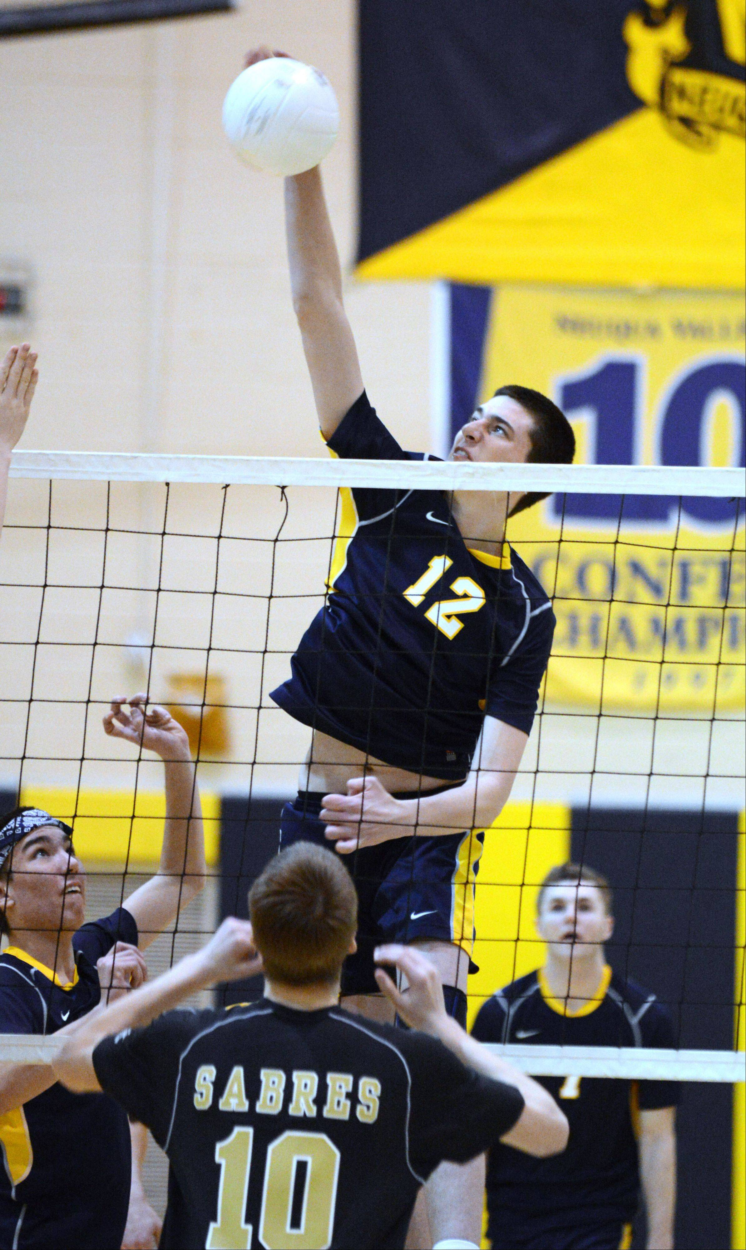 Griffin Shields of Neuqua Valley goes up for a hit during the Streamwood at Neuqua Valley boys volleyball game Tuesday.