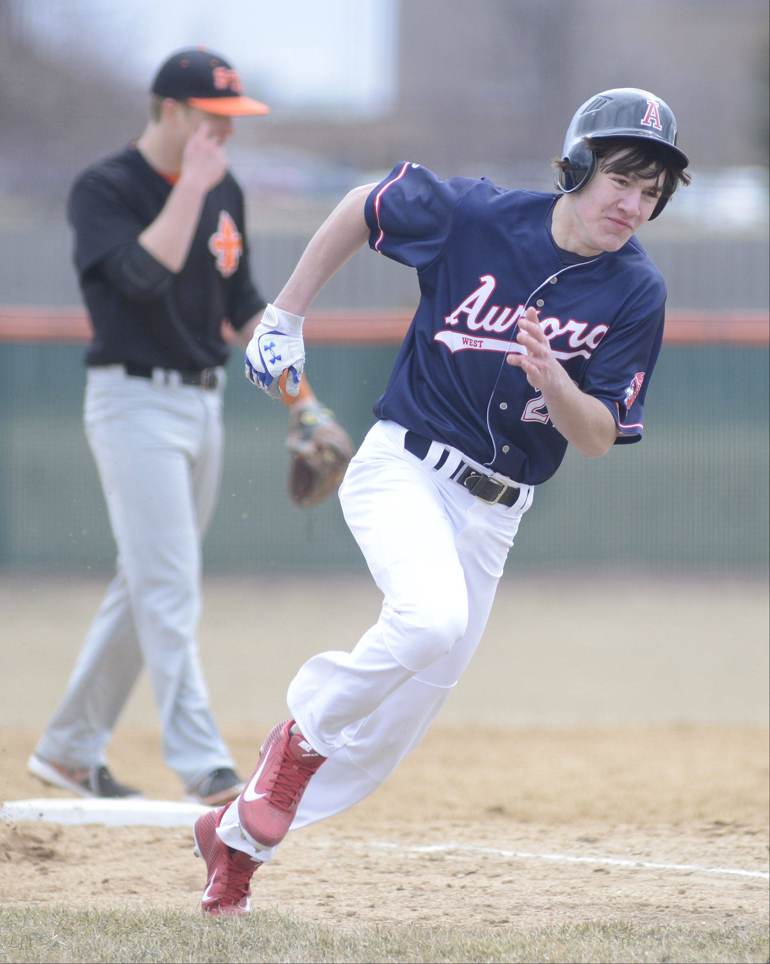 West Aurora's D.J., Varney rounds third base and makes his way home for the only run of the game Tuesday in St. Charles.
