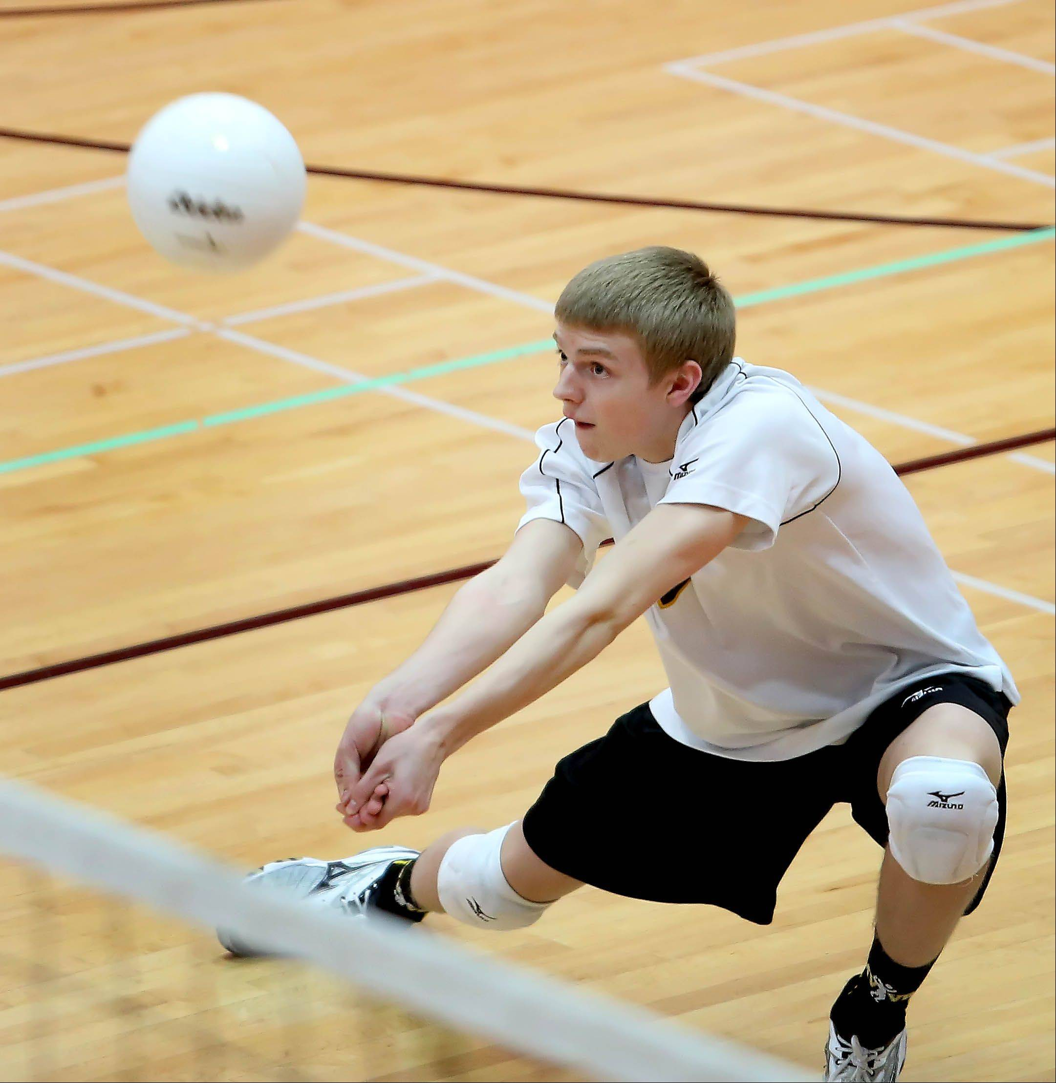 Metea Valley's Tom Wieland returns a serve from Hindsdale Central during Tuesday's volleyball game in Hinsdale.