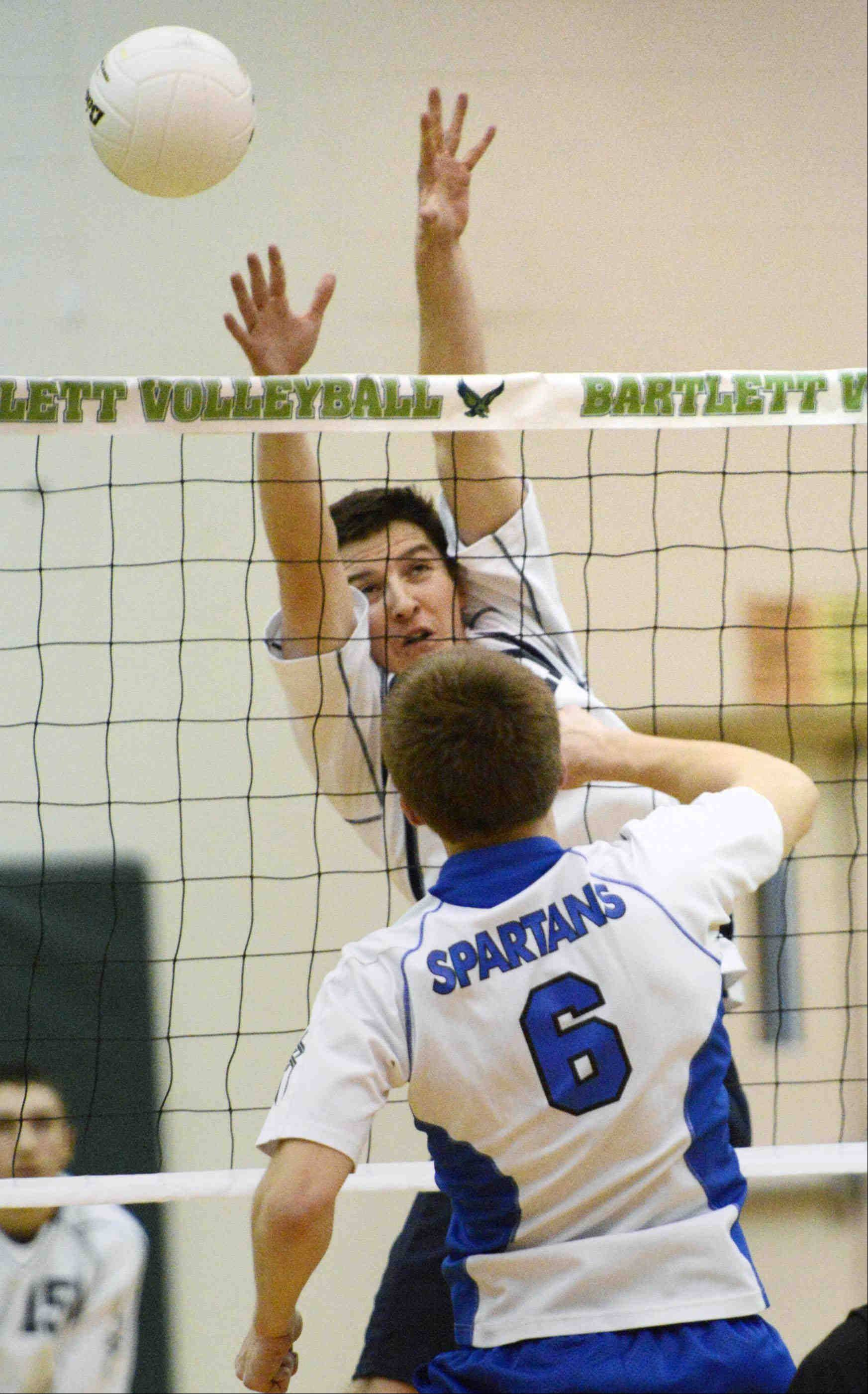 Bartlett's Jack Blum tries to block a shot by St. Francis' Greg Churney Wednesday in Bartlett.