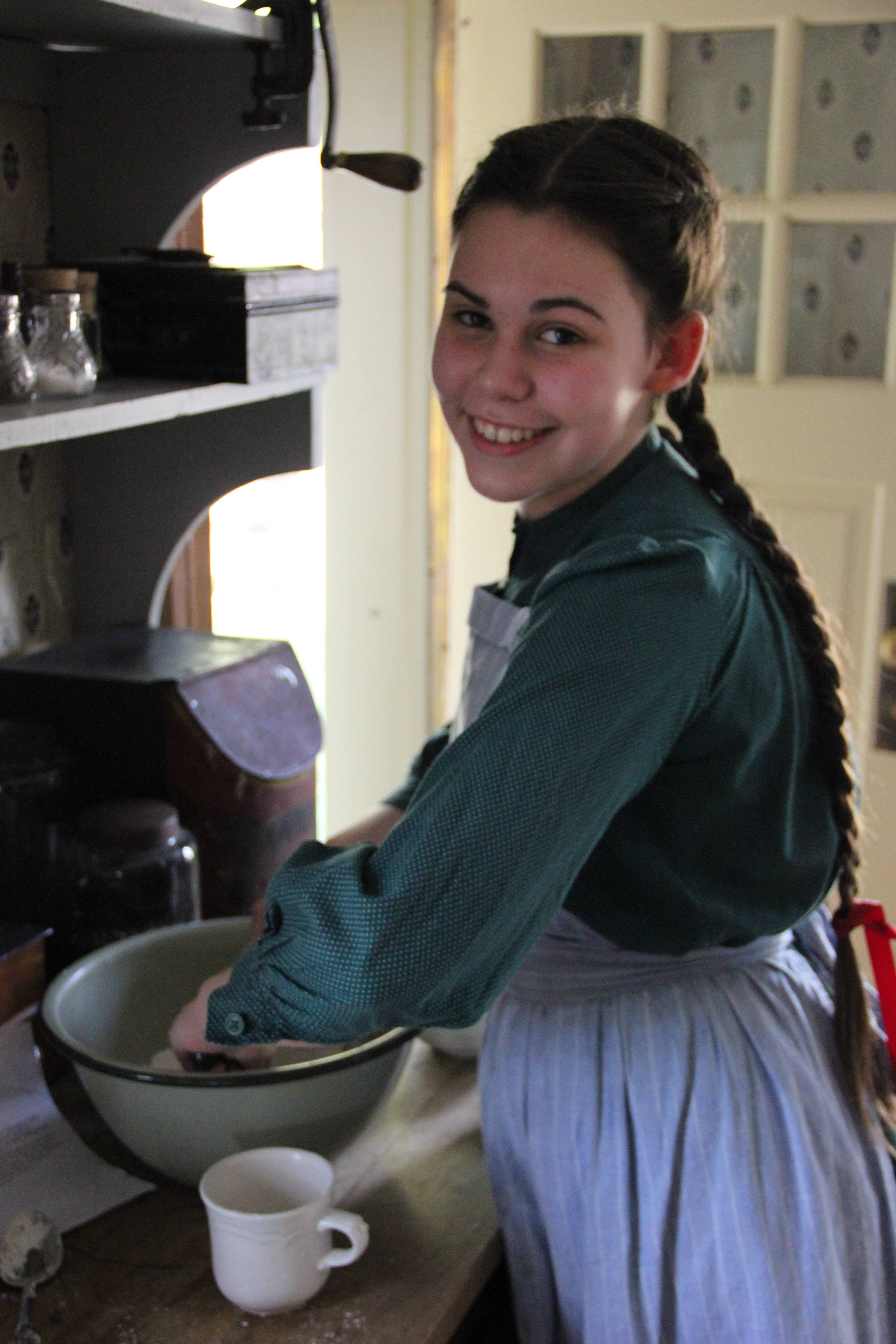 A Heritage Farm volunteer prepares treats at a recent special event.