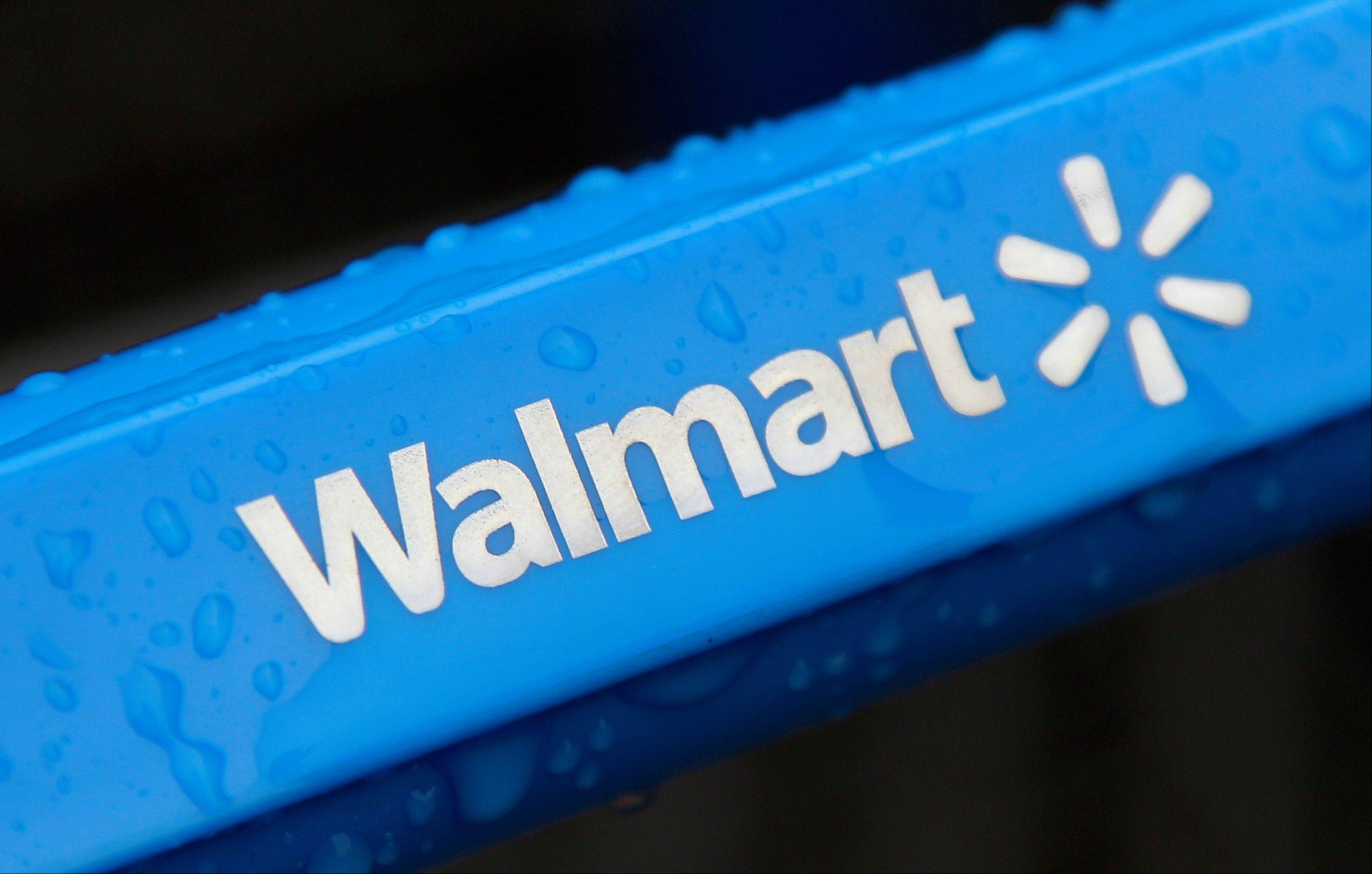 Wal-Mart Stores Inc., the world�s largest retailer, is trying out new delivery methods and adding to its mobile technology to improve Web-based shopping and step up its challenge to Amazon.com Inc.