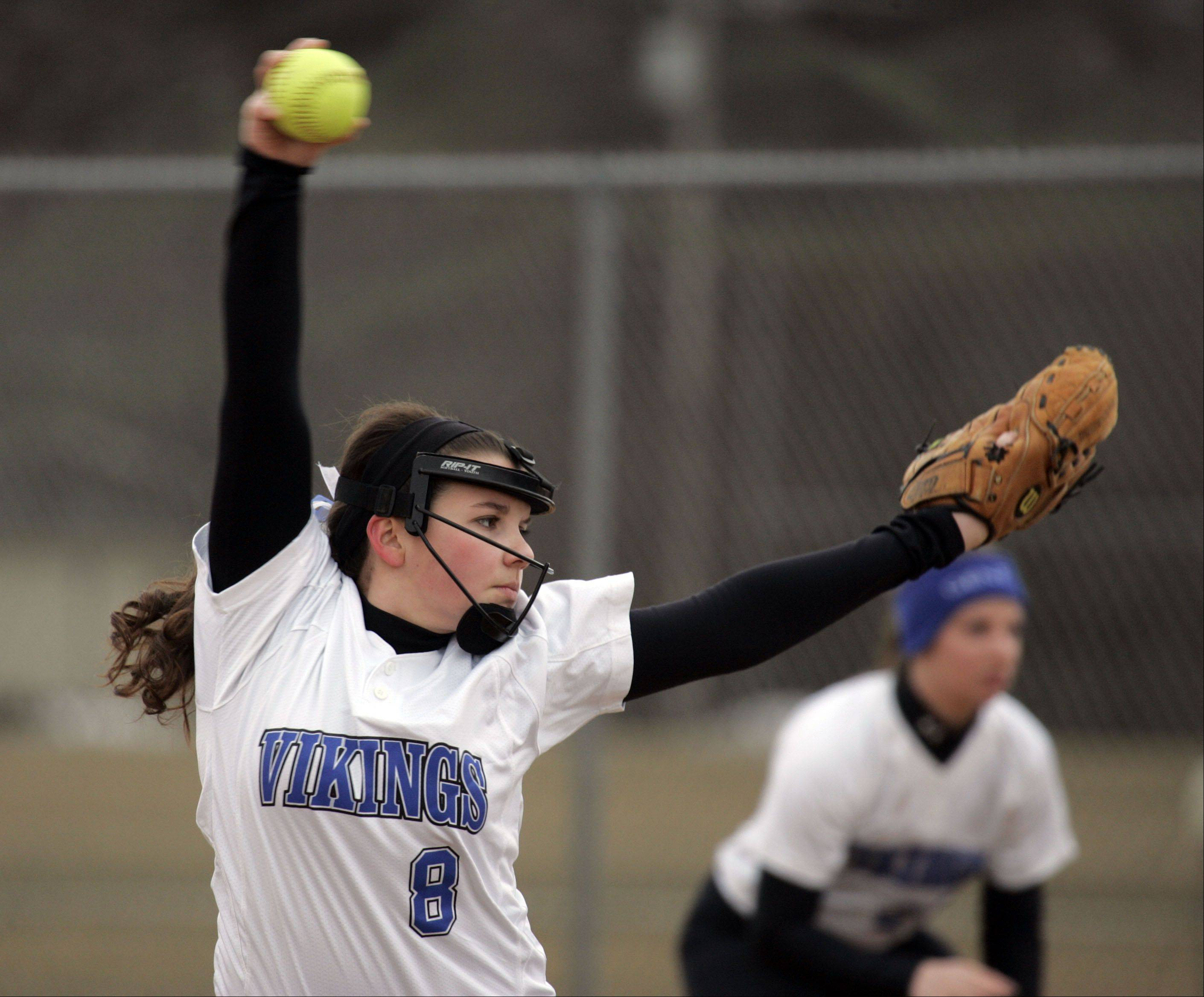 Geneva�s Haley Orwig, 8, delivers her pitch at home against Oswego Wednesday.