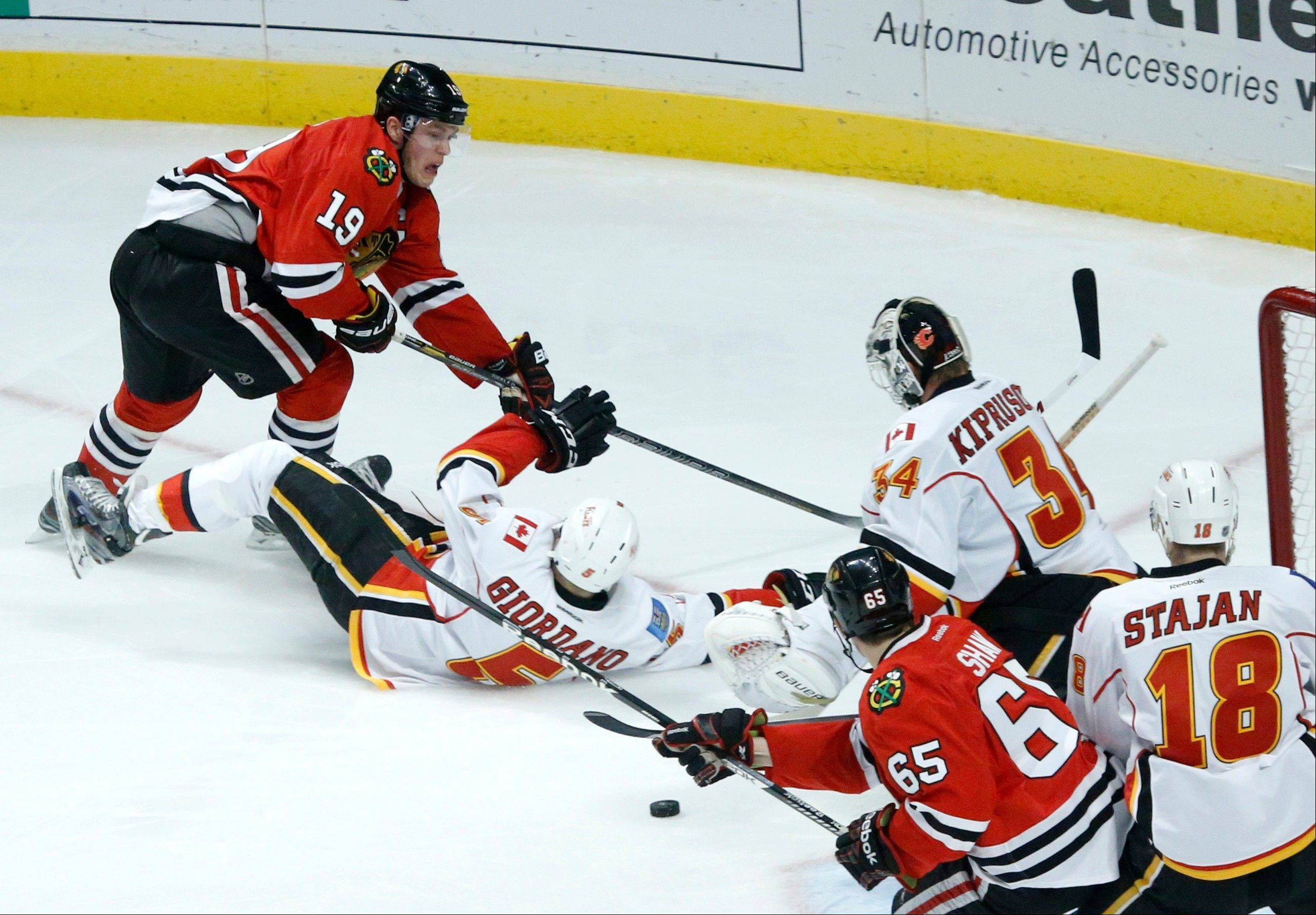 Calgary Flames goalie Miikka Kiprusoff gave up a pair of goals by the Blackhawks Tuesday, but the Hawks failed to convert on five power play chances.