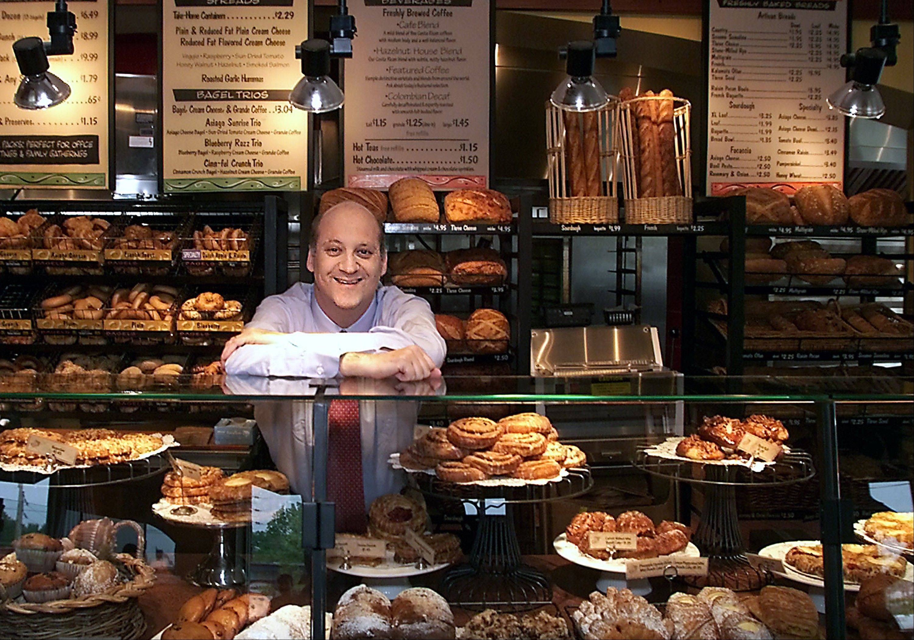 In this May, 2002, photo Panera Bread Co. CEO Ron Shaich stands behind a counter in a St. Louis cafe.