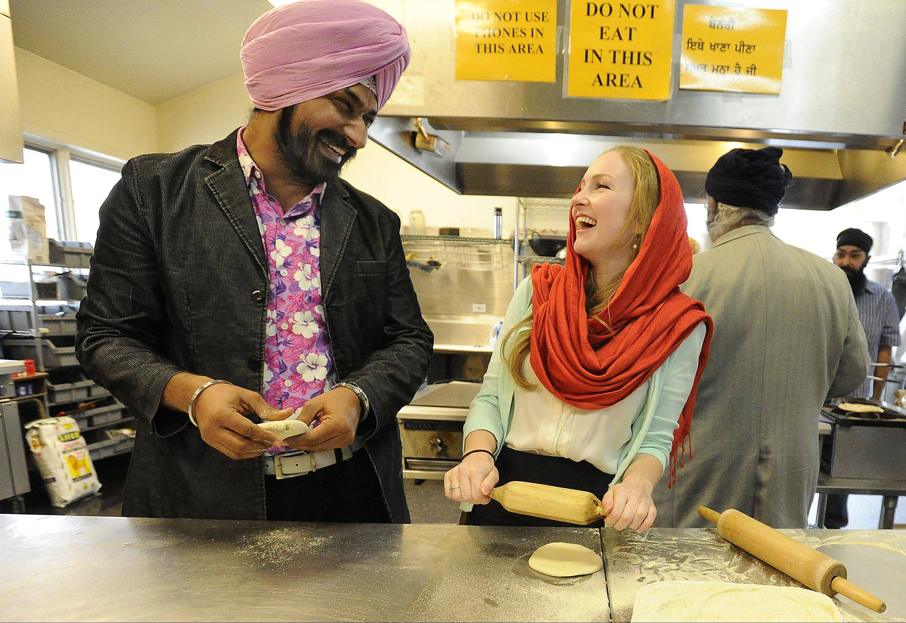 Gurucharan Singh, who starred in a popular Indian sitcom, makes chapatis with former co-star Kari Irwin of Palatine while visiting the Sikh Religious Society Temple in Palatine.