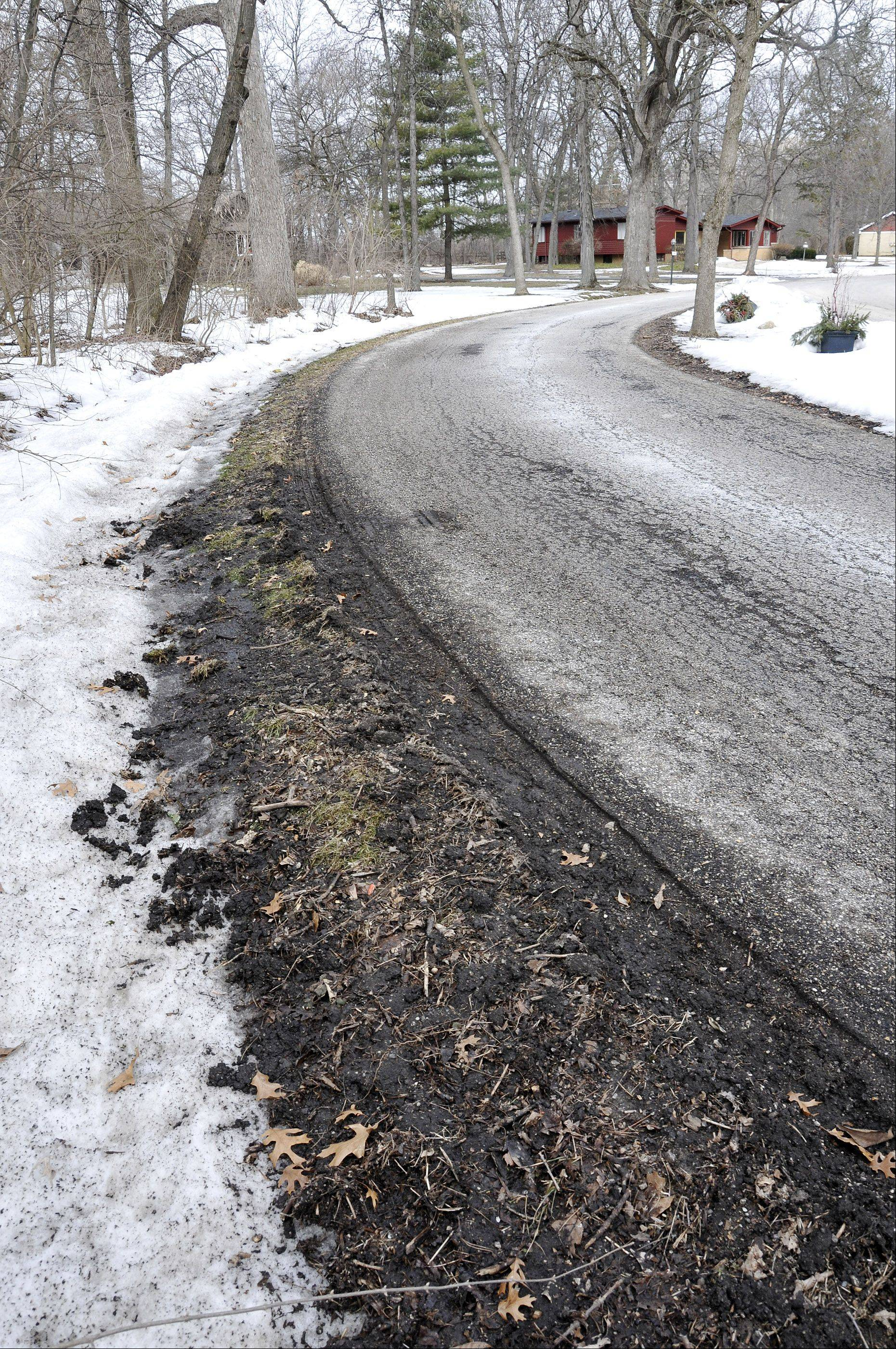 The deteriorating conditions of residential roads like West Mardan Drive has Long Grove candidates weighing whether to ask voters to approve the village's first property tax to fund much-needed road repairs.