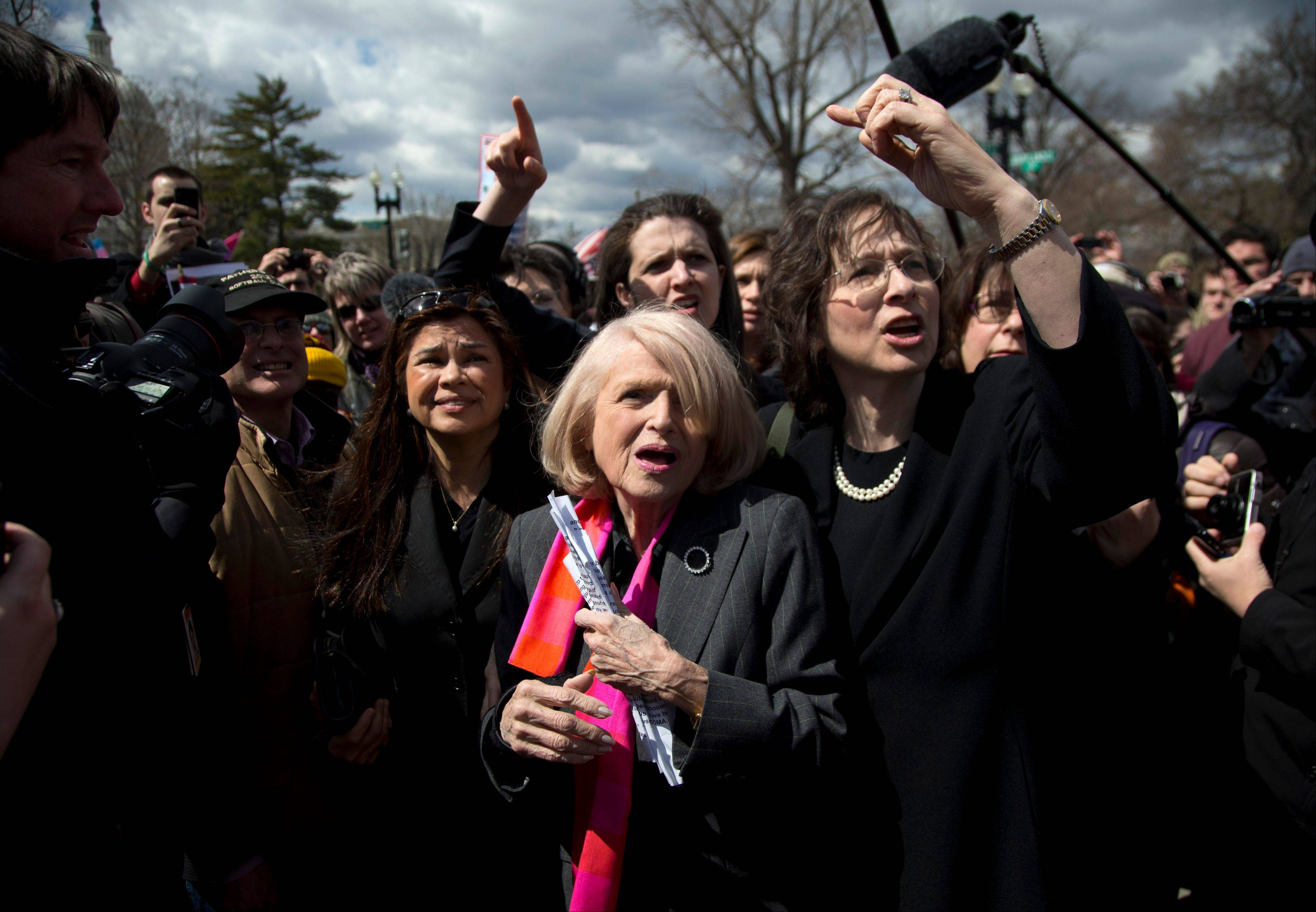 Plaintiff Edith Windsor of New York, center, tries to move through the crowd in front of the Supreme Court in Washington, Wednesday. The U.S. Supreme Court, in the second day of gay marriage cases, turned Wednesday to a constitutional challenge to the federal law that prevents legally married gay Americans from collecting federal benefits generally available to straight married couples.