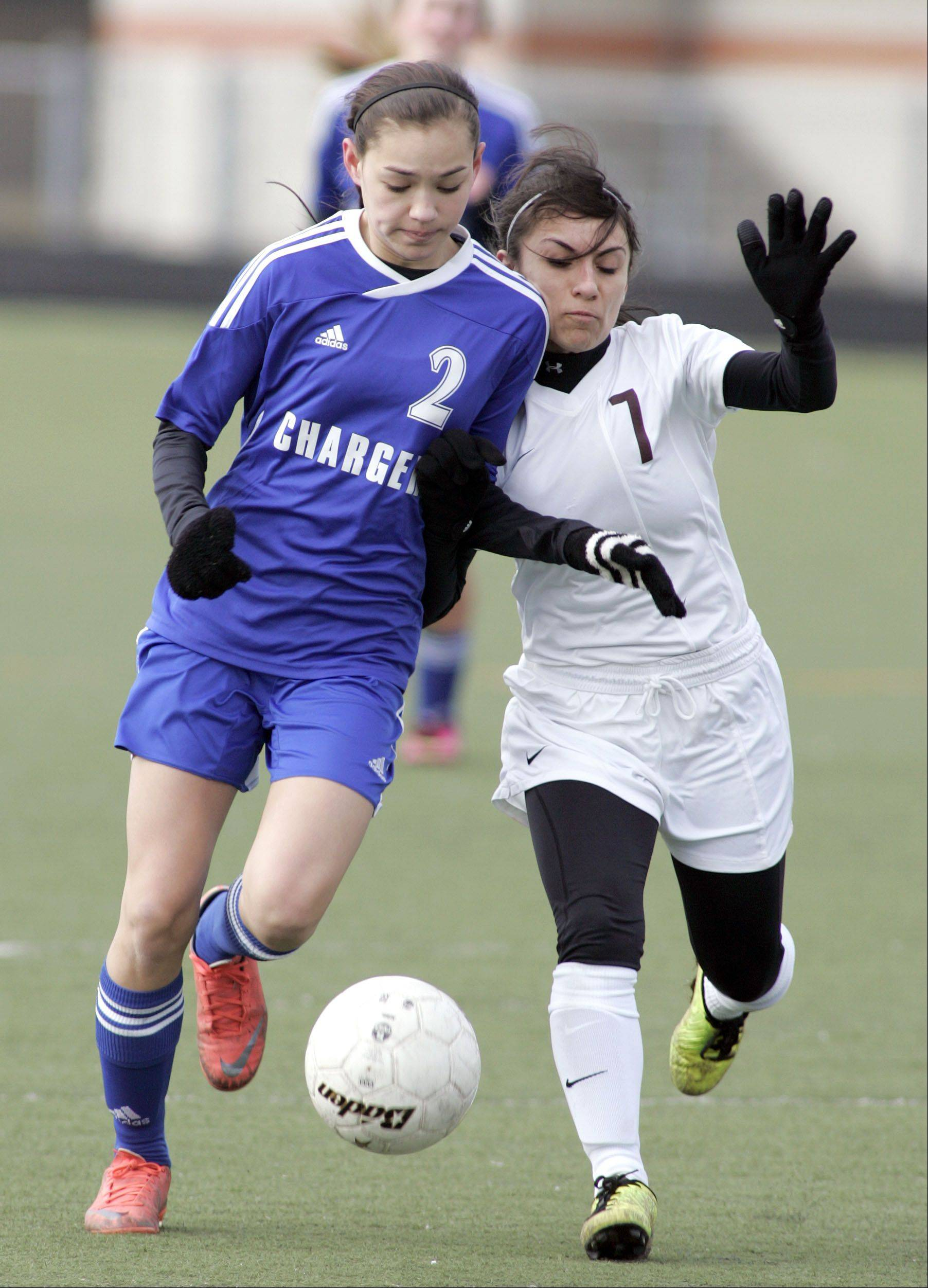 Elgin's Maria Gomez (7) battles Dundee-Crown's Jennifer Letheby during South Elgin Spring Break tournament at Millennium Field in Streamwood Wednesday.