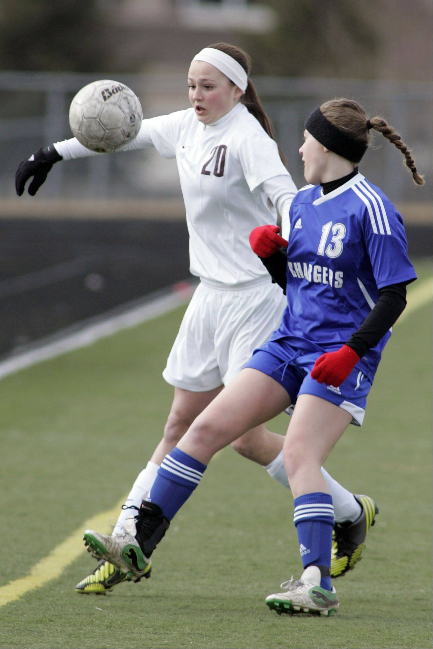 Elgin's Hannah Demel (20) battles Dundee-Crown's Cori Schrade during the South Elgin Spring Break tournament at Millennium Field in Streamwood Wednesday.