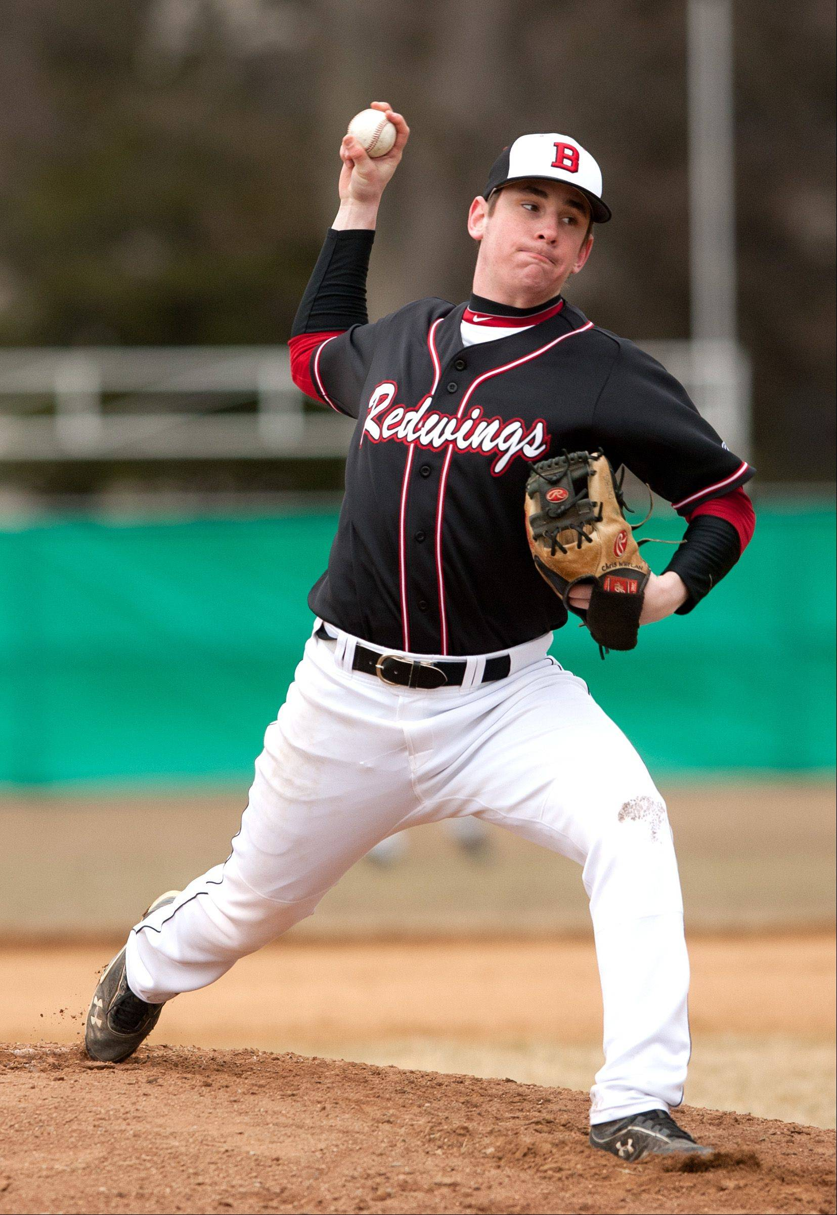 Benet's Chris Whelan delivers a pitch against York during baseball action in Elmhurst.