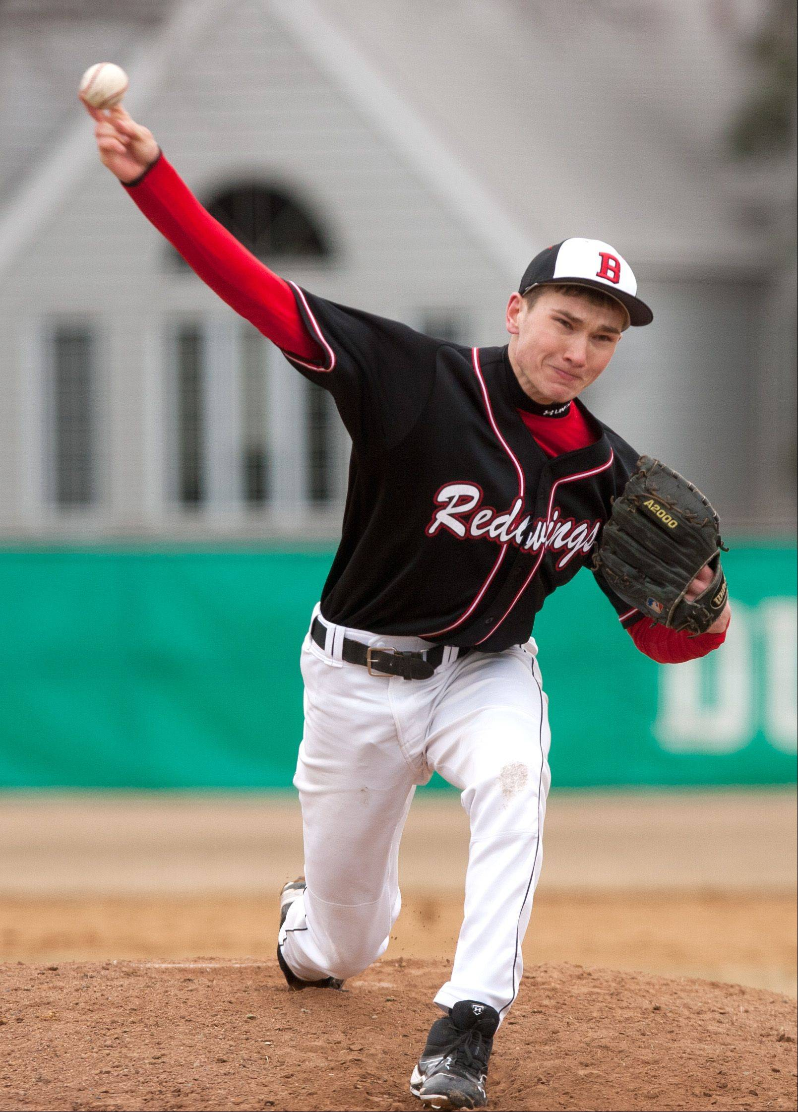 Benet's Brendan Pullen delivers a pitch against York during baseball action in Elmhurst.