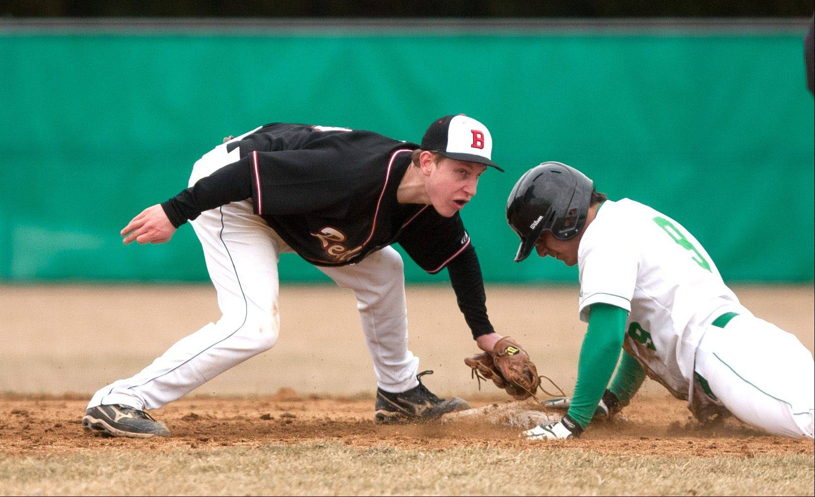 York's Louis Alcaraz slides safely under a Benet tag, during baseball action in Elmhurst.
