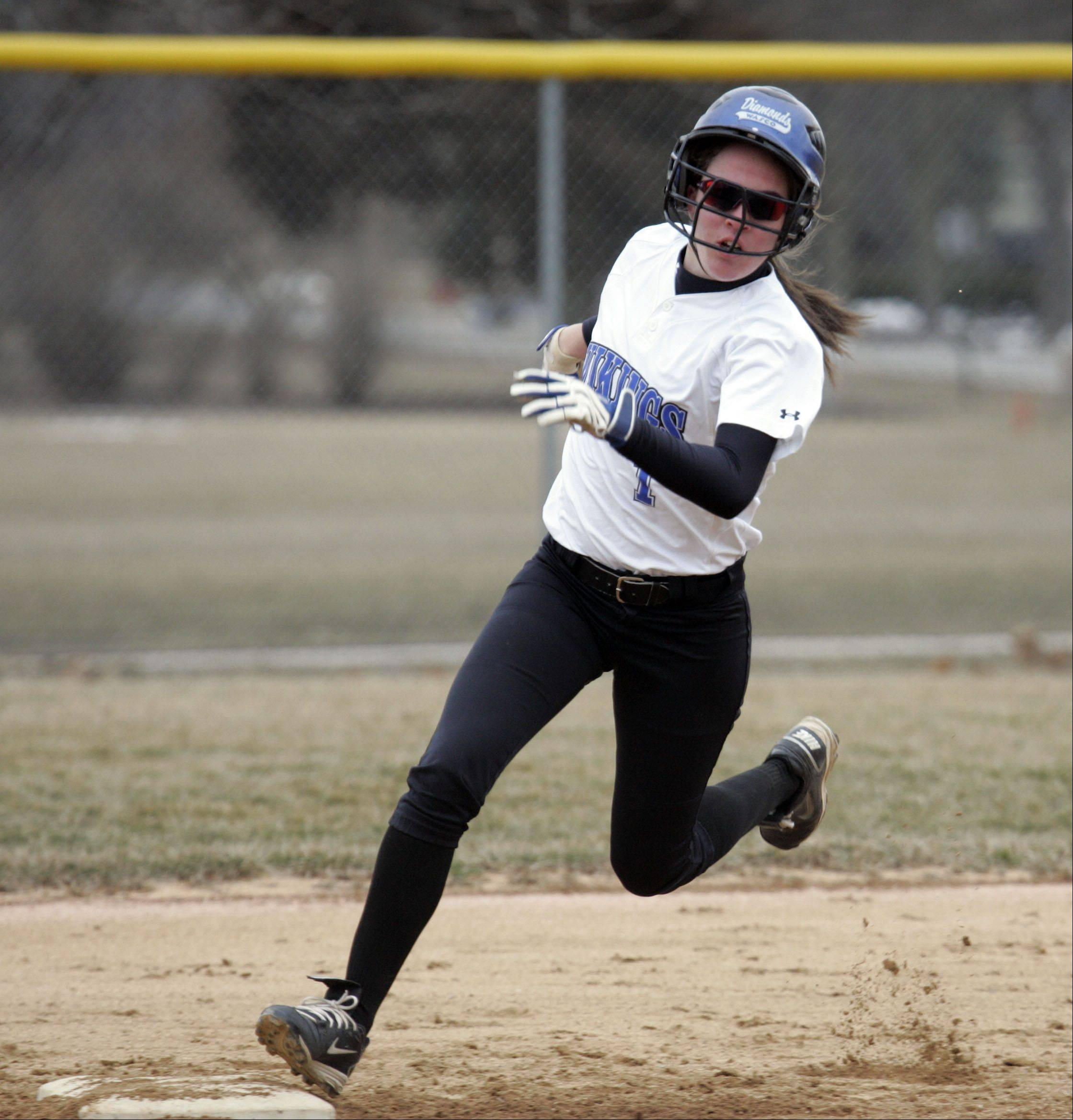 Bridget Weitzel rounds second on her way to third base during Geneva's 7-5 win over Oswego.