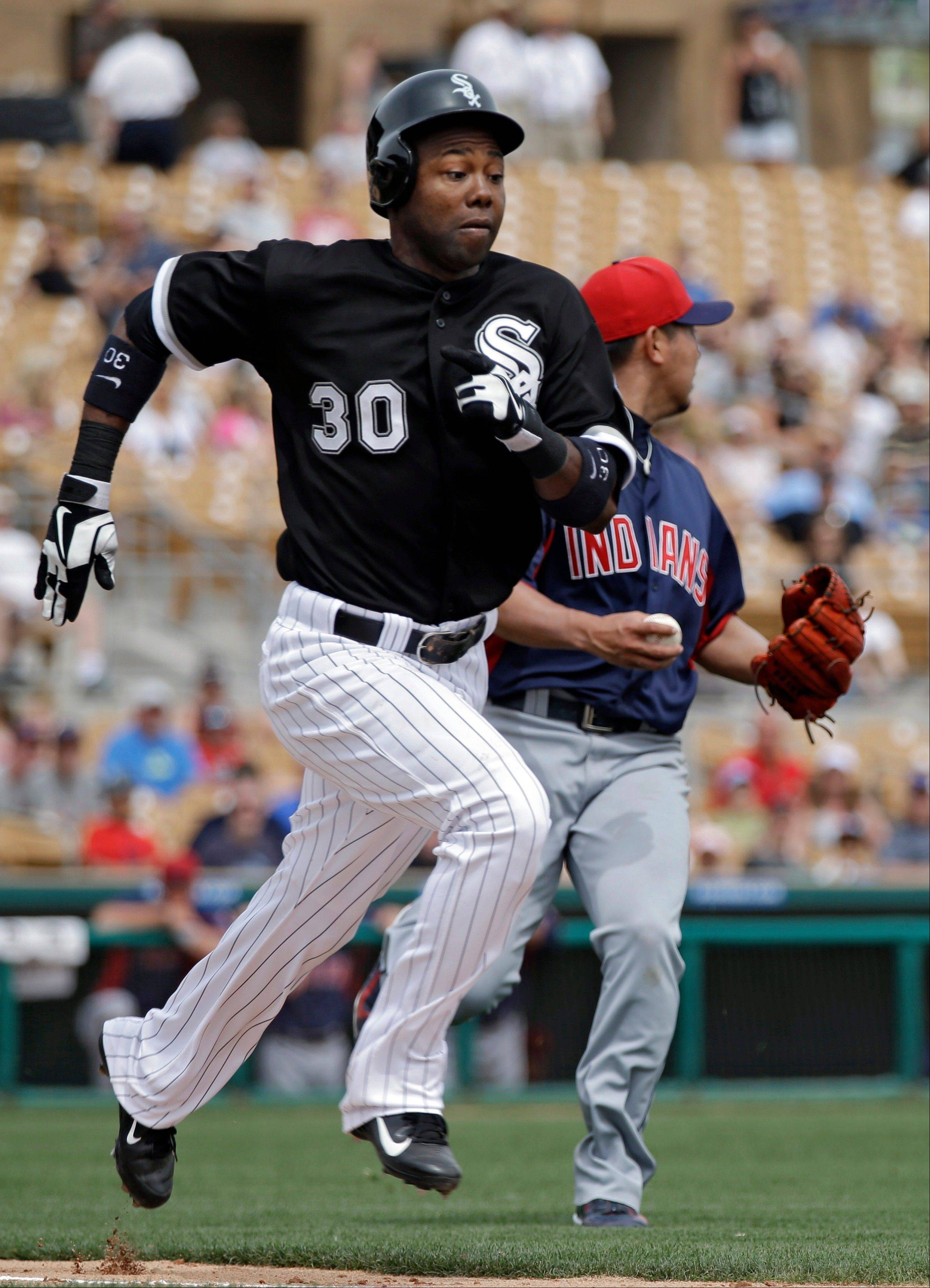 Chicago White Sox's Alejandro De Aza (30) races to first past Cleveland Indians starting pitcher Daisuke Matsuzaka on an RBI bunt single in the fifth inning of a spring training baseball game Wednesday, March 27, 2013, in Glendale, Ariz.