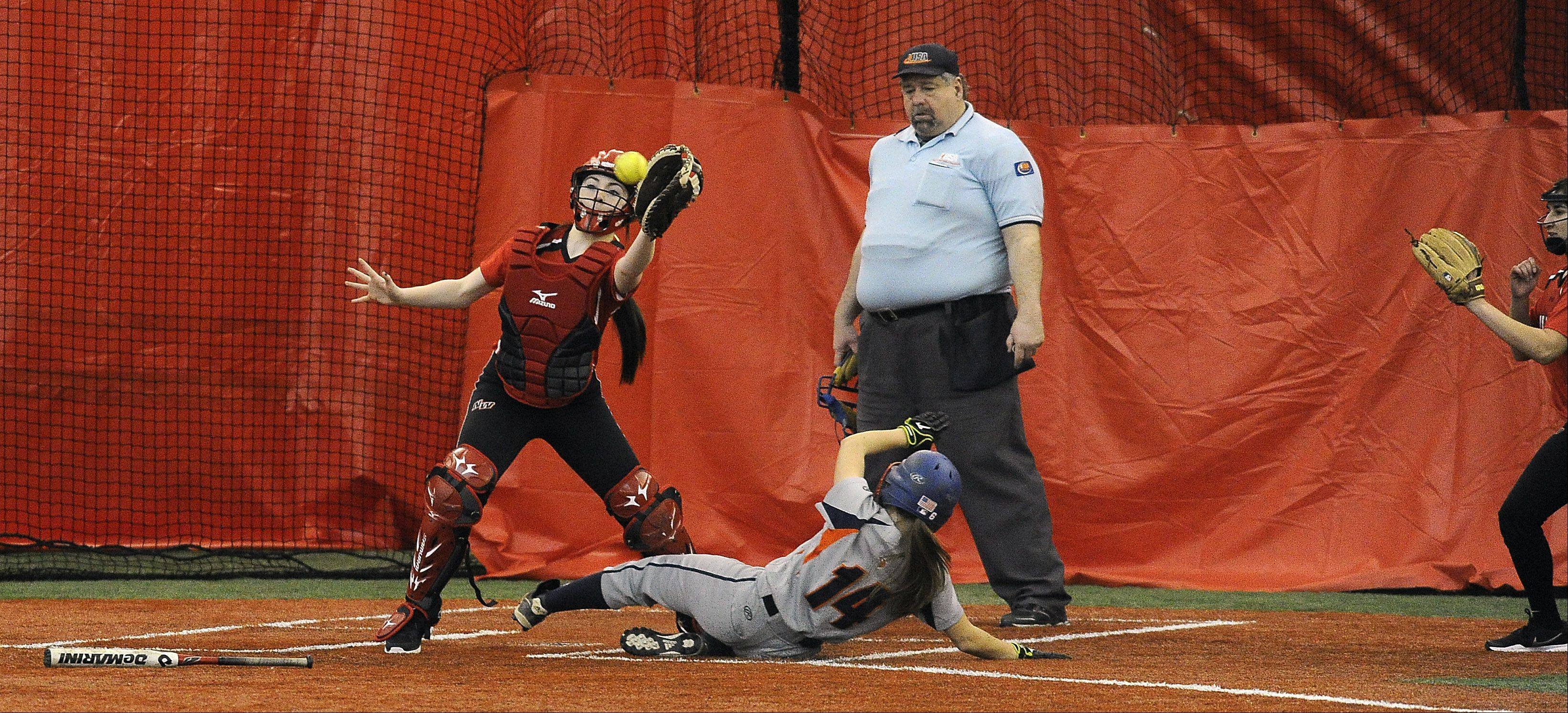 Niles West catcher Shannon McHugh fields a late throw in the seventh inning as Buffalo Grove's Michelle Dublin slides safely into home after a hit by teammate Maddi Morini at the Dome at the Ballpark in Rosemont on Wednesday.