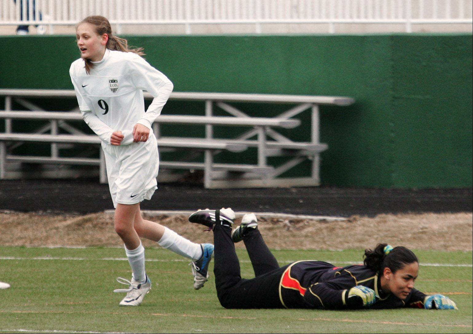 Grayslake fmidfielder Emily Werfel celebrates after scoring past Grant goalie Ana Rodas in the second half Wednesday at Grayslake Central.